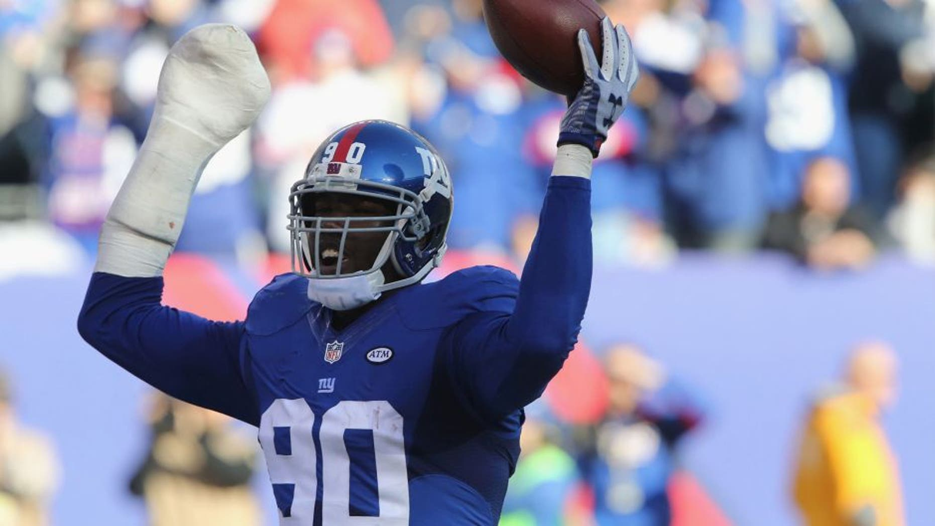 Defensive End Jason Pierre-Paul #90 of the New York Giants has a fumble recovery against the New York Jets at MetLife Stadium on December 6, 2015 in East Rutherford, New Jersey. (Photo by Al Pereira/Getty Images for New York Jets)