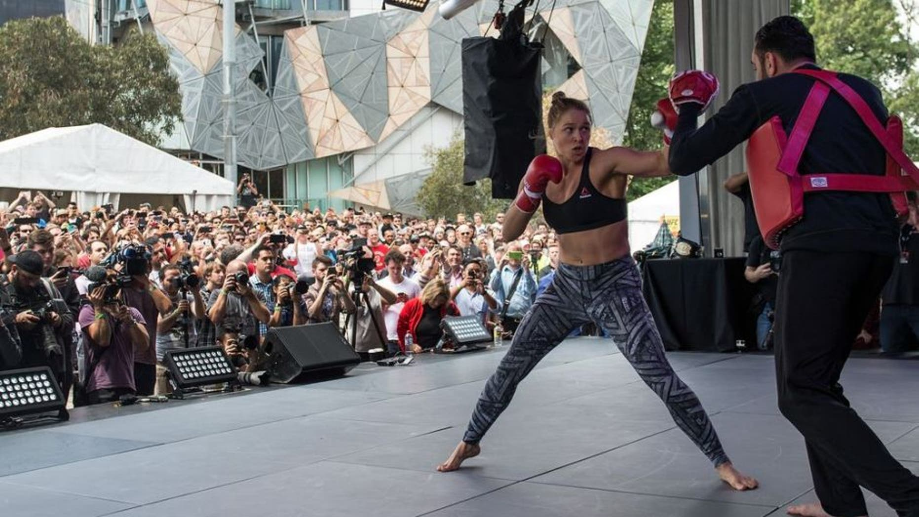 MELBOURNE, AUSTRALIA - NOVEMBER 12: UFC women's bantamweight champion Ronda Rousey of the United States holds an open workout for fans and media at Federation Square on November 12, 2015 in Melbourne, Australia. (Photo by Brandon Magnus/Zuffa LLC/Zuffa LLC via Getty Images)