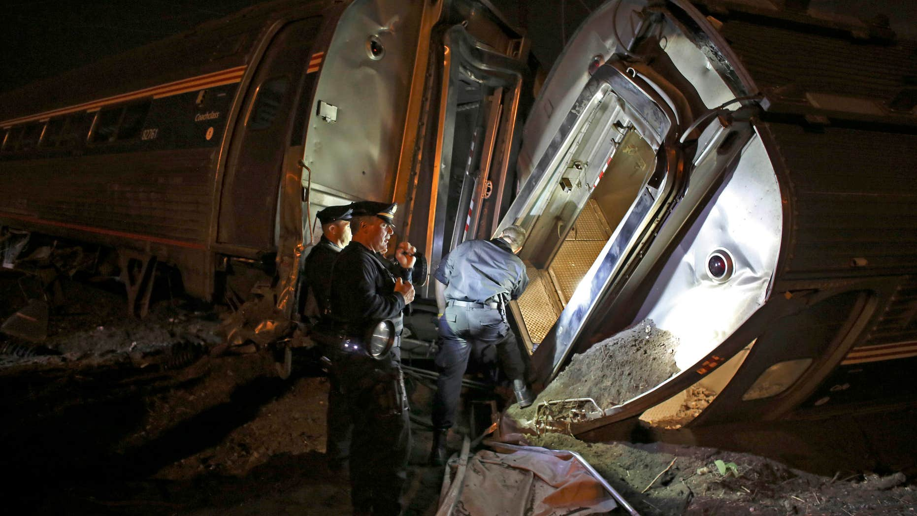 May 12, 2015: Emergency personnel work the scene of a train wreck An Amtrak train headed to New York City derailed and crashed in Philadelphia.