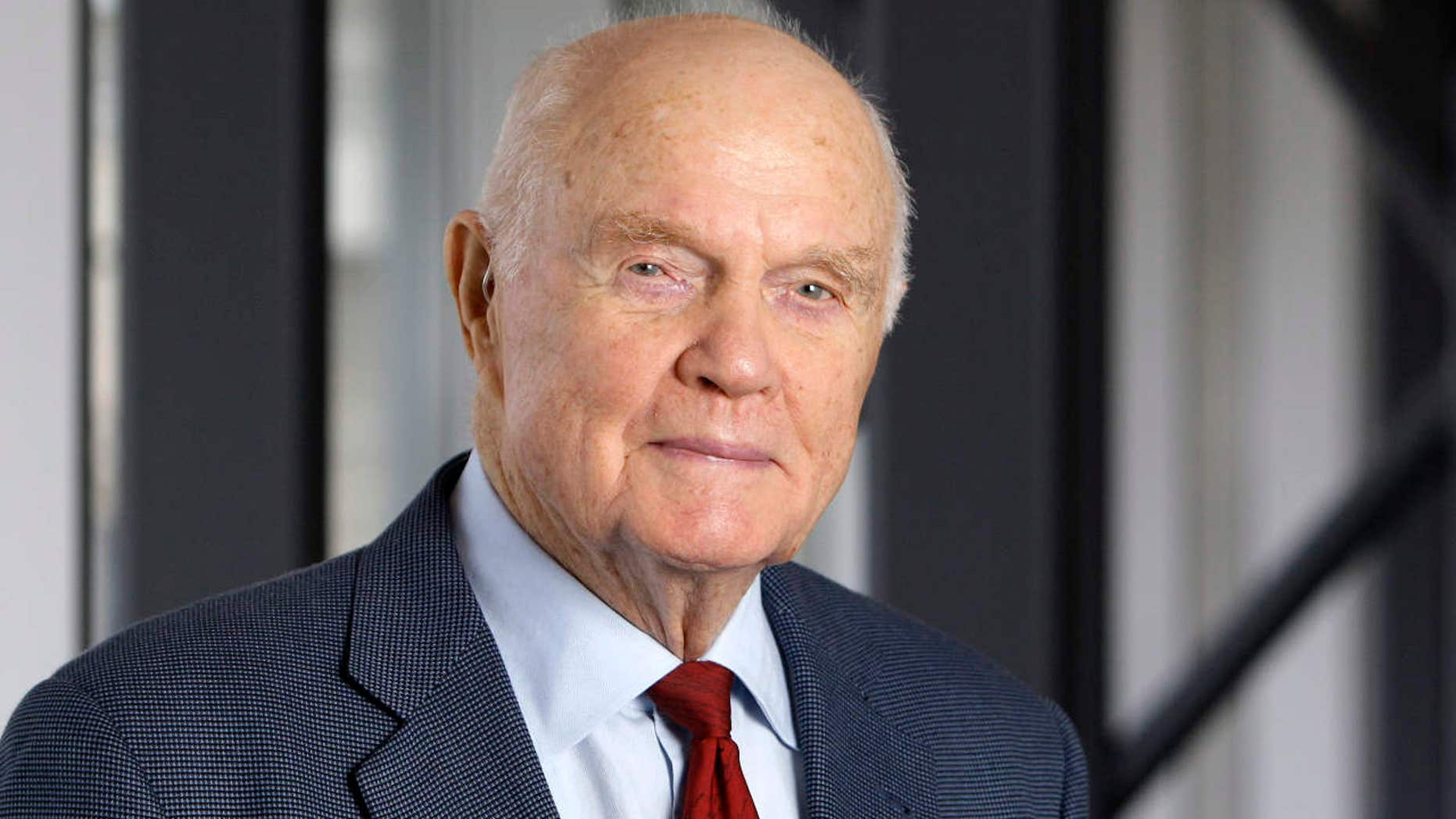FILE - In this Jan. 25, 2012, file photo, former astronaut and Sen. John Glenn poses for a photo during an interview at his office in Columbus, Ohio.