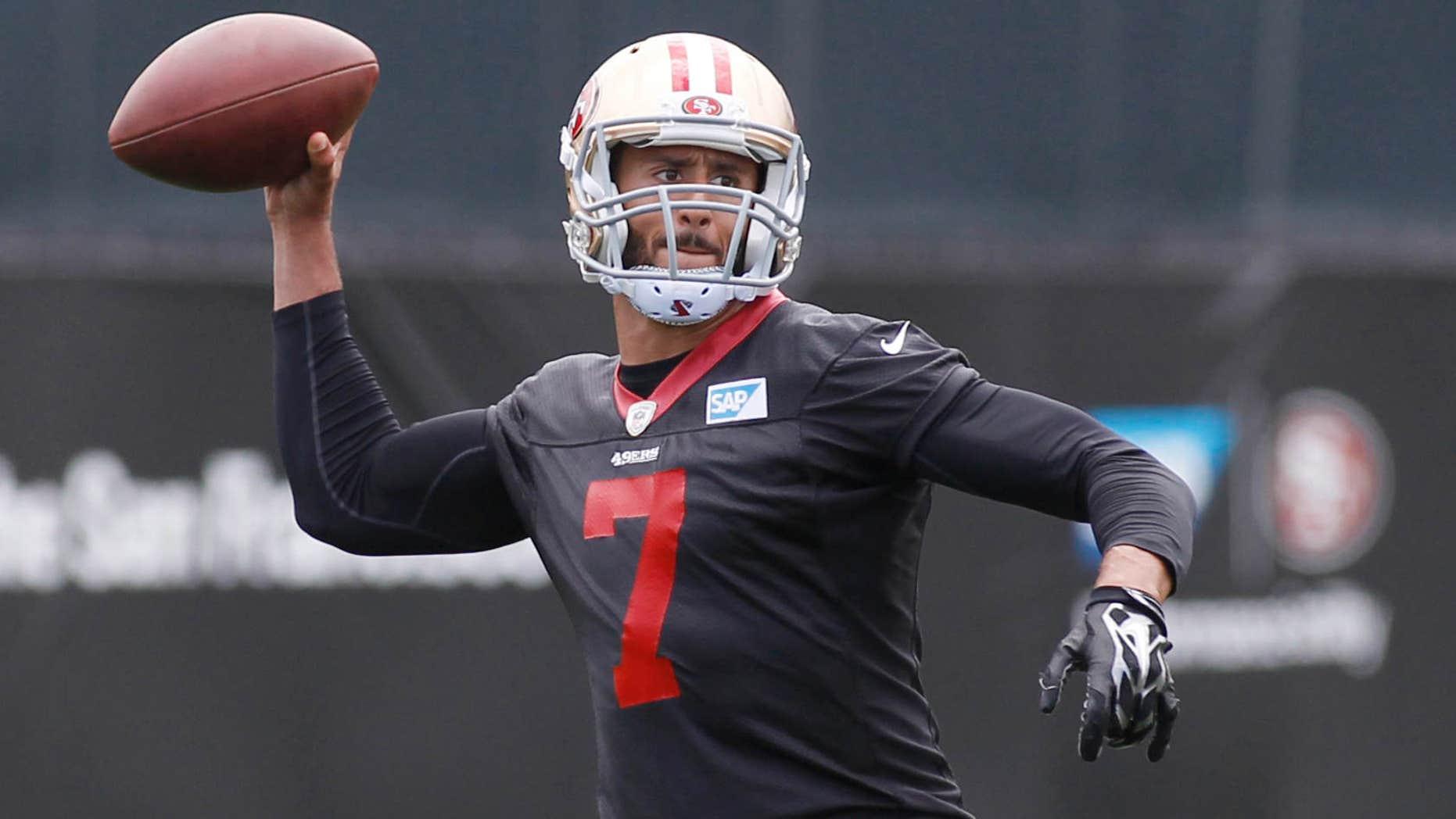 May 21, 2015: San Francisco 49ers quarterback Colin Kaepernick throws the ball during NFL football practice.