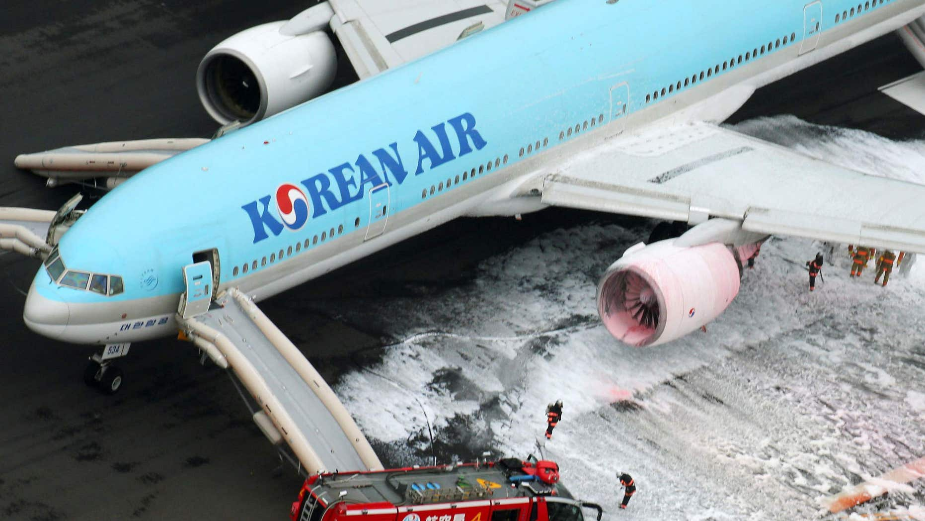 May 27, 2016: An aerial picture shows fire fighters spraying foam at the engine of a Korean Air Lines plane after smoke rose from it at Haneda airport in Tokyo, Japan.