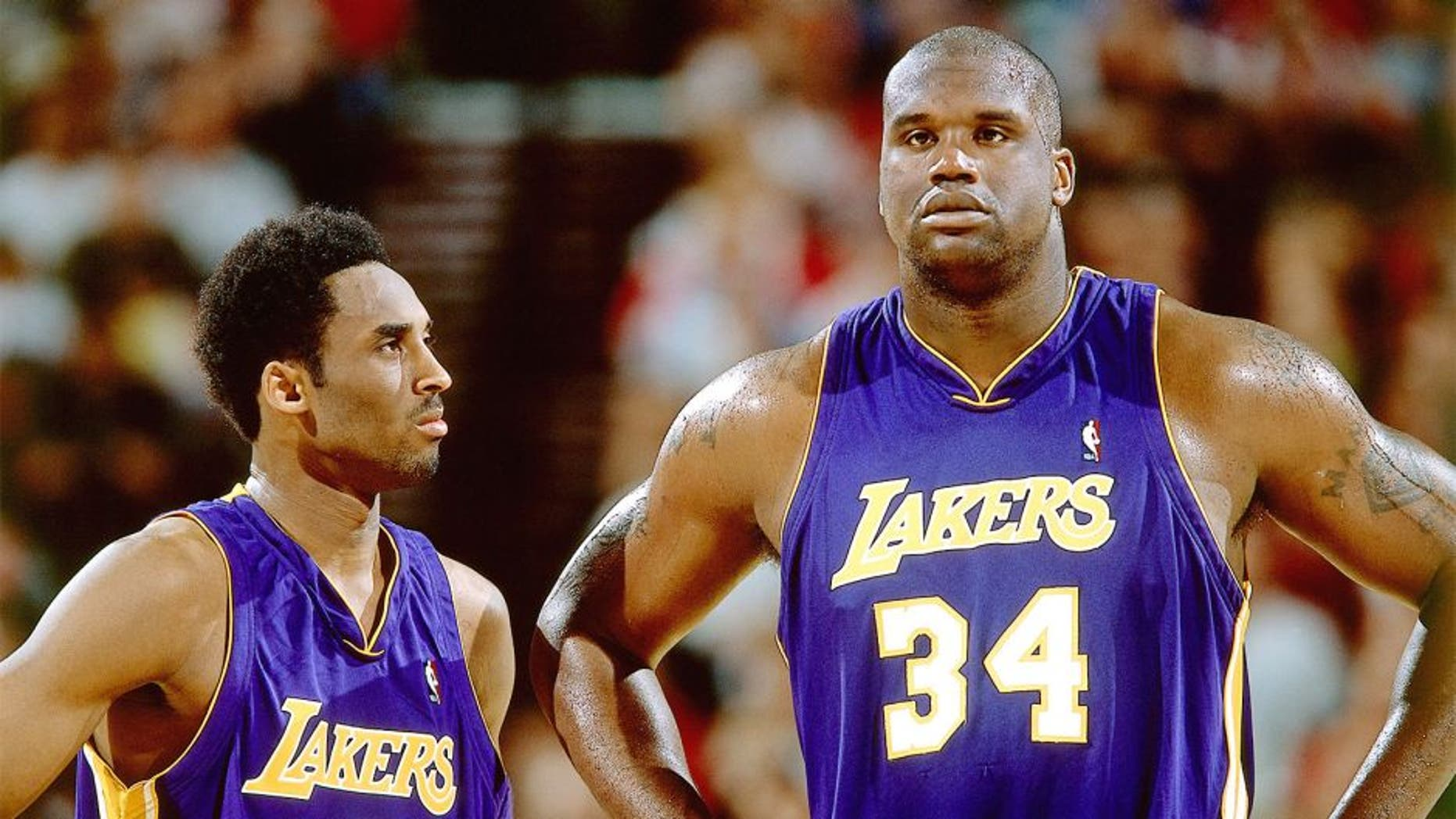 2001: Kobe Bryant #8 and Shaquille O'Neal #34 of the Los Angeles Lakers look on during an NBA game circa 2001. NOTE TO USER: User expressly acknowledges and agrees that, by downloading and/or using this Photograph, User is consenting to the terms and conditions of the Getty Images License Agreement. Mandatory Copyright Notice: Copyright 2001 NBAE (Photo by Sam Forencich/NBAE via Getty Images)