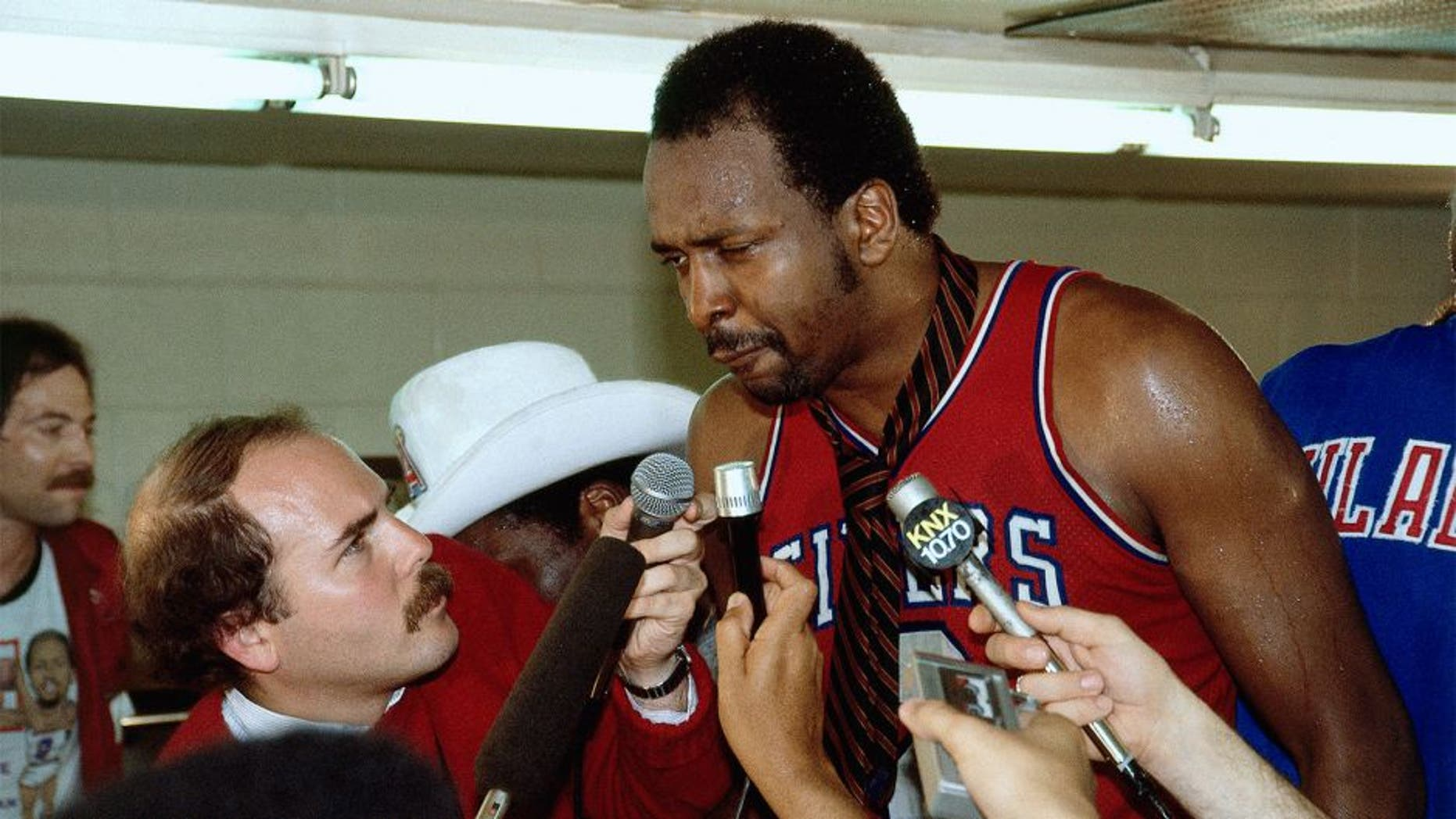 LOS ANGELES - 1983: Moses Malone #2 of the Philadelphia 76'ers gets interviewed by the media after winning the 1983 NBA Championship against the Los Angeles Lakers at the Forum in Los Angleles, California. NOTE TO USER: User expressly acknowledges and agrees that, by downloading and or using this photograph, User is consenting to the terms and conditions of the Getty Images License Agreement. (Photo by Andrew D. Bernstein/ NBAE/ Getty Images)