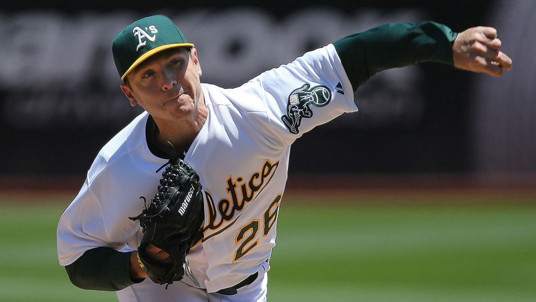 May 27, 2015; Oakland, CA, USA; Oakland Athletics starting pitcher Scott Kazmir (26) pitches the ball against the Detroit Tigers during the second inning at O.co Coliseum. Mandatory Credit: Kelley L Cox-USA TODAY Sports