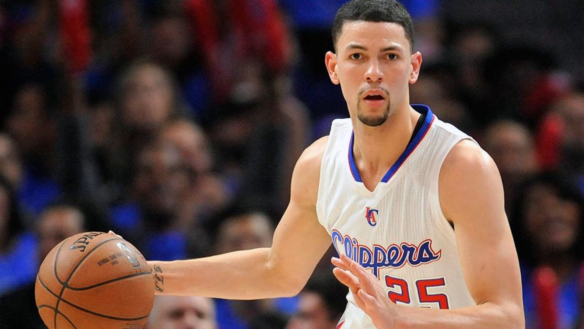 May 8, 2015; Los Angeles, CA, USA; Los Angeles Clippers guard Austin Rivers (25) controls the ball against the Houston Rockets during the second half in game three of the second round of the NBA Playoffs. at Staples Center. Mandatory Credit: Gary A. Vasquez-USA TODAY Sports