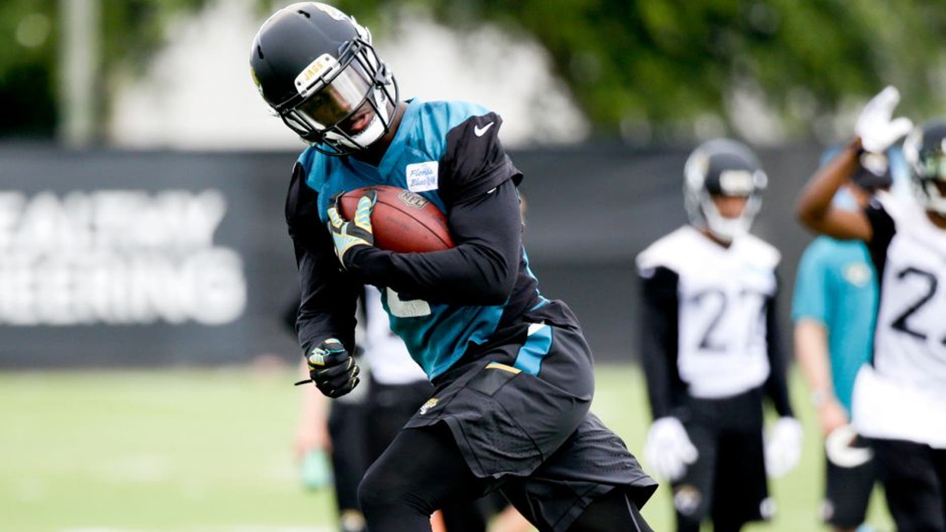 Jacksonville Jaguars running back T.J. Yeldon carries the ball during a drill at NFL football organized training activities, Tuesday, May 26, 2015, in Jacksonville, Fla. (AP Photo/John Raoux)