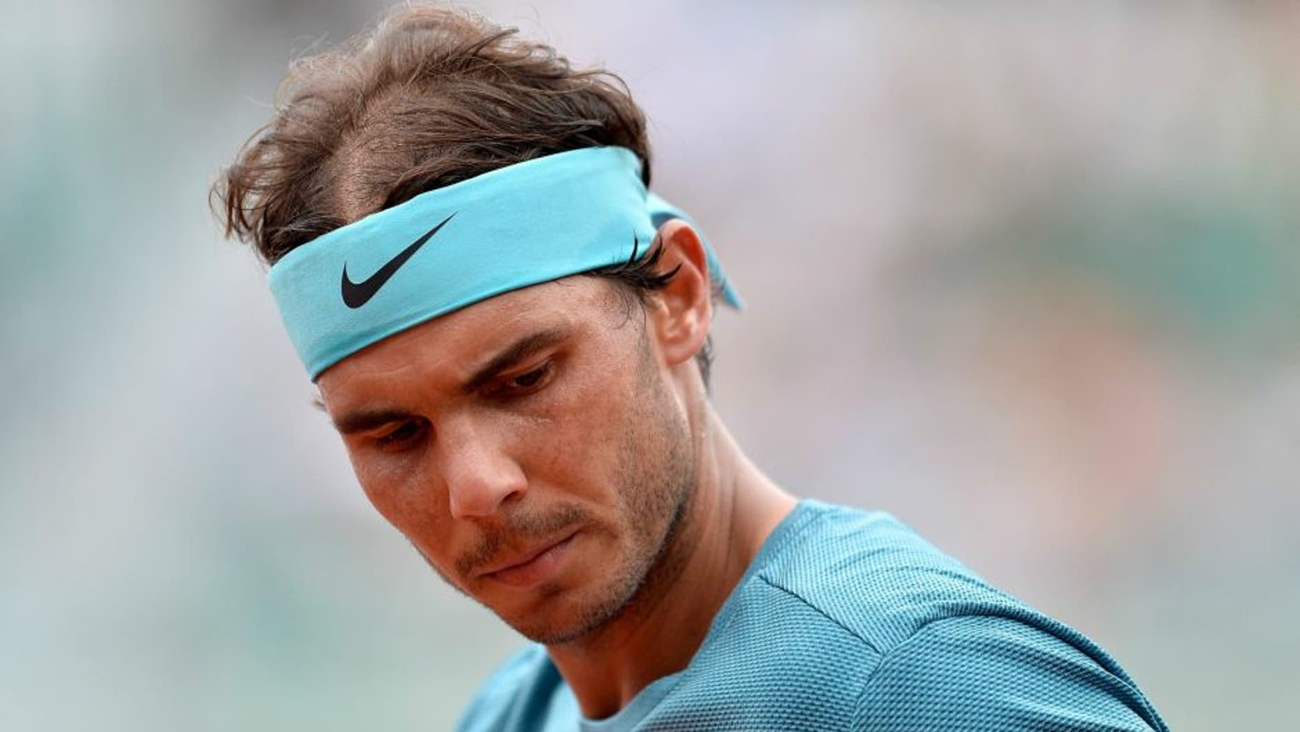PARIS, FRANCE - MAY 26: Rafael Nadal of Spain reacts during his men's single second round match against Facundo Bagnis of Argentina on day five of the 2016 French Open at Roland Garros on May 26, 2016 in Paris, France. (Photo by Aurelien Meunier/Getty Images)
