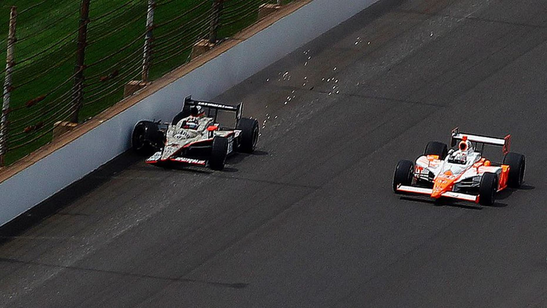 29 May, 2011, Indianapolis, Indiana, USA Dan Wheldon passes the crashed JR Hildebrand for the win