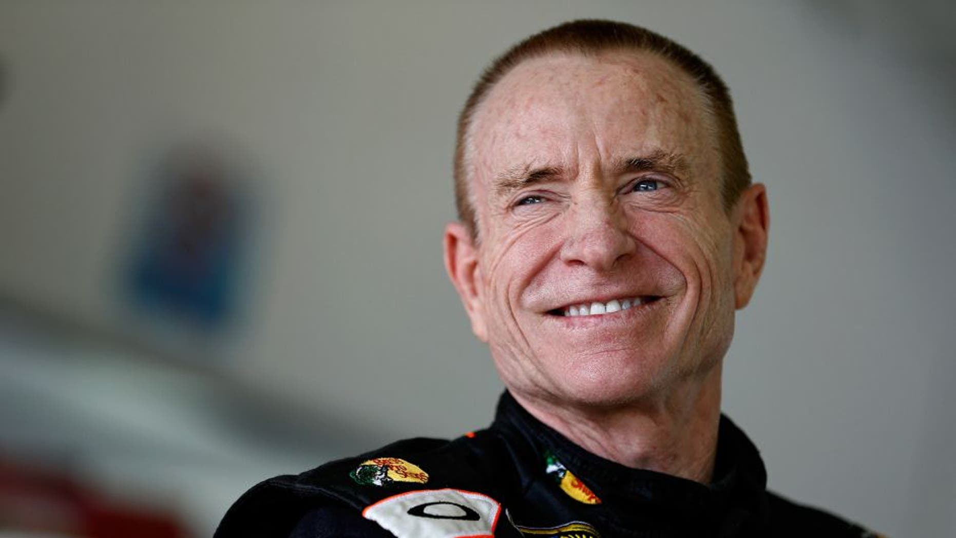 HOMESTEAD, FL - NOVEMBER 16: Mark Martin, driver of the #14 Bass Pro Shops / Mobil 1 Chevrolet, stands in the garage during practice for the NASCAR Sprint Cup Series Ford EcoBoost 400 at Homestead-Miami Speedway on November 16, 2013 in Homestead, Florida. (Photo by Jeff Zelevansky/NASCAR via Getty Images)