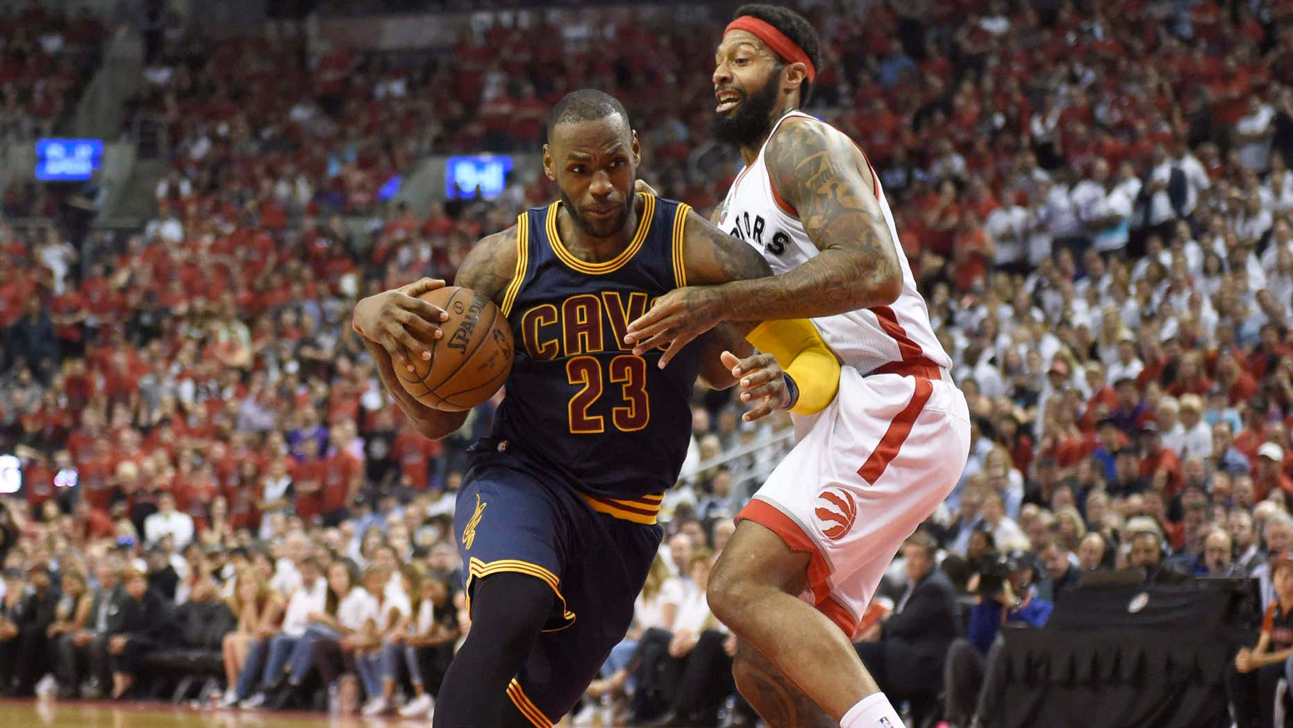 Cleveland Cavaliers forward LeBron James drives to the basket as Toronto Raptors forward James Johnson defends during the second half of Game 6 of the NBA basketball Eastern Conference finals, Friday, May 27, 2016, in Toronto.