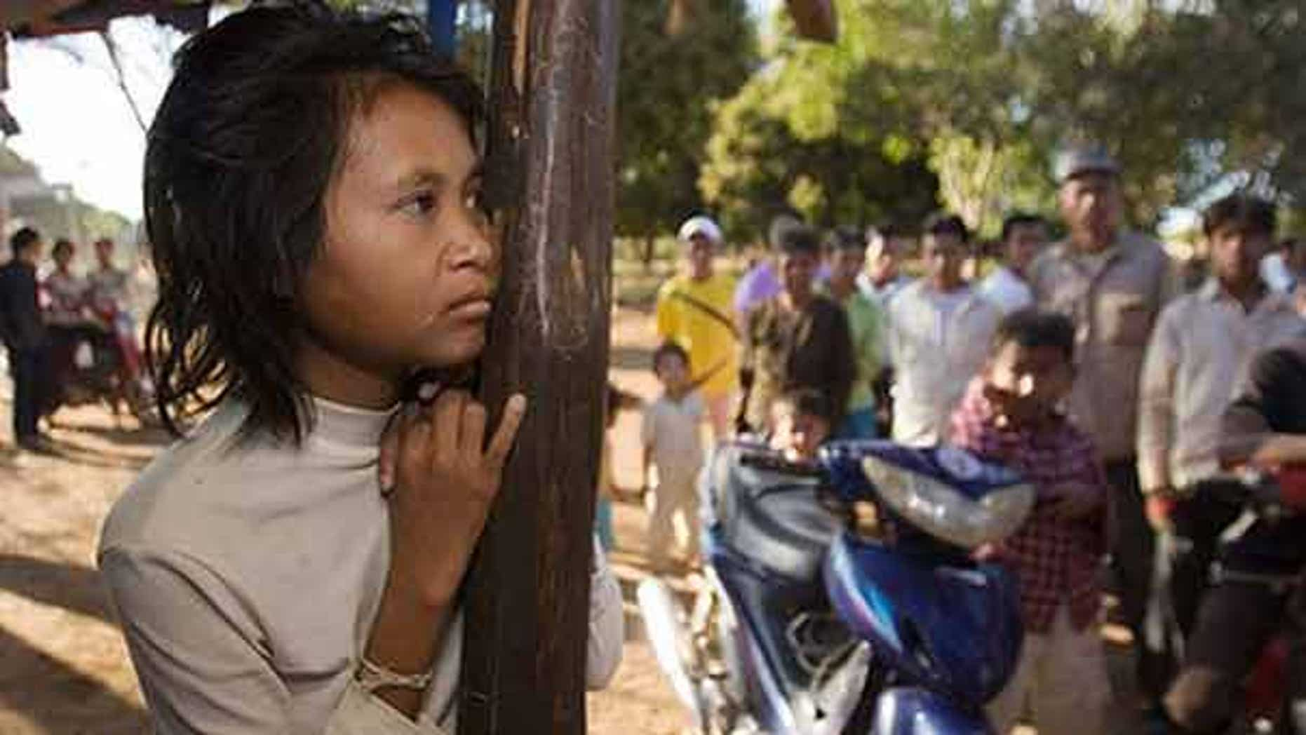 """FILE: A woman dubbed the """"jungle woman"""" after emerging naked and unable to speak from the wilds of northeastern Cambodia three years ago has apparently fled back to the forest, police said."""