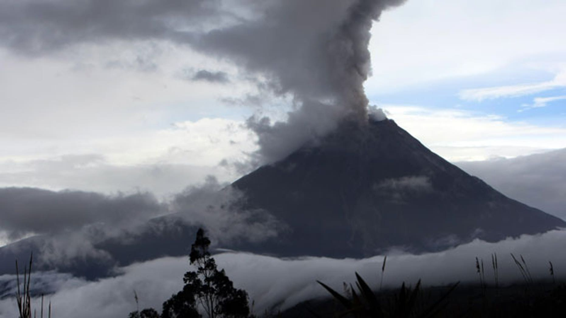 May 28: A view of the Tungurahua volcano throwing ashes in Huambalo, in Ecuador's central highlands.