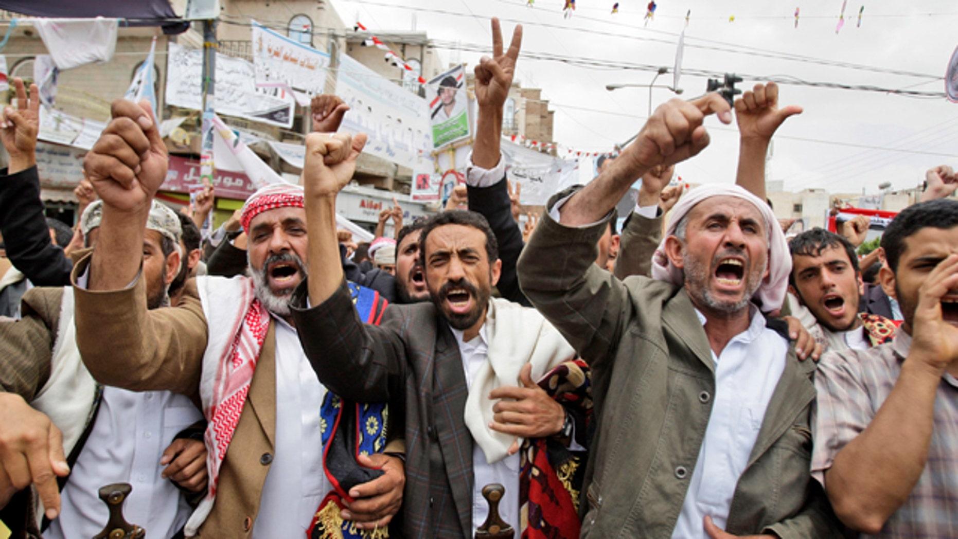 May 28: Anti-government protestors shout slogans during a demonstration demanding the resignation of Yemeni President Ali Abdullah Saleh in Sanaa, Yemen.