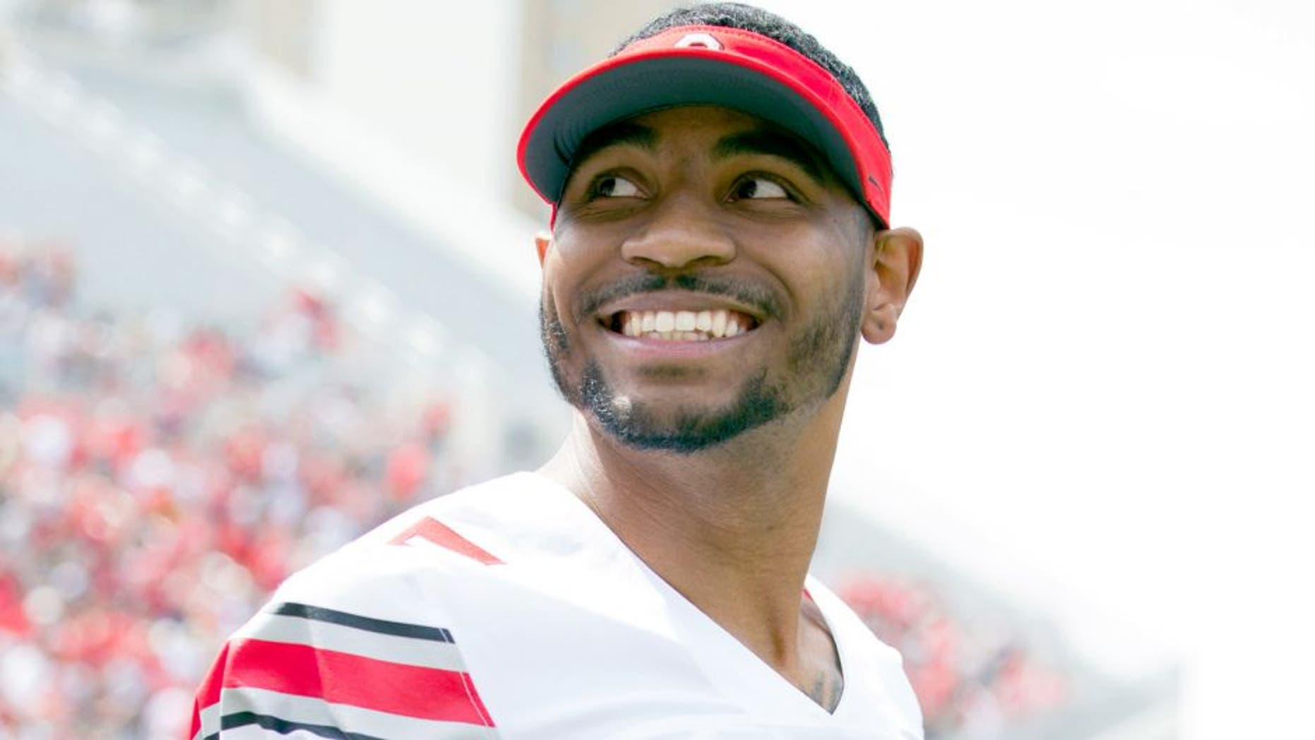Apr 18, 2015; Columbus, OH, USA; Ohio State Gray Team quarterback Braxton Miller (5) reacts to the fans during the Ohio Spring Game at Ohio Stadium. Mandatory Credit: Greg Bartram-USA TODAY Sports