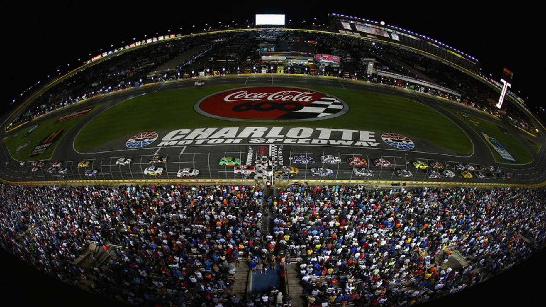 CONCORD, NC - MAY 26: The field restart during the NASCAR Sprint Cup Series Coca-Cola 600 at Charlotte Motor Speedway on May 26, 2013 in Concord, North Carolina. (Photo by Streeter Lecka/Getty Images)