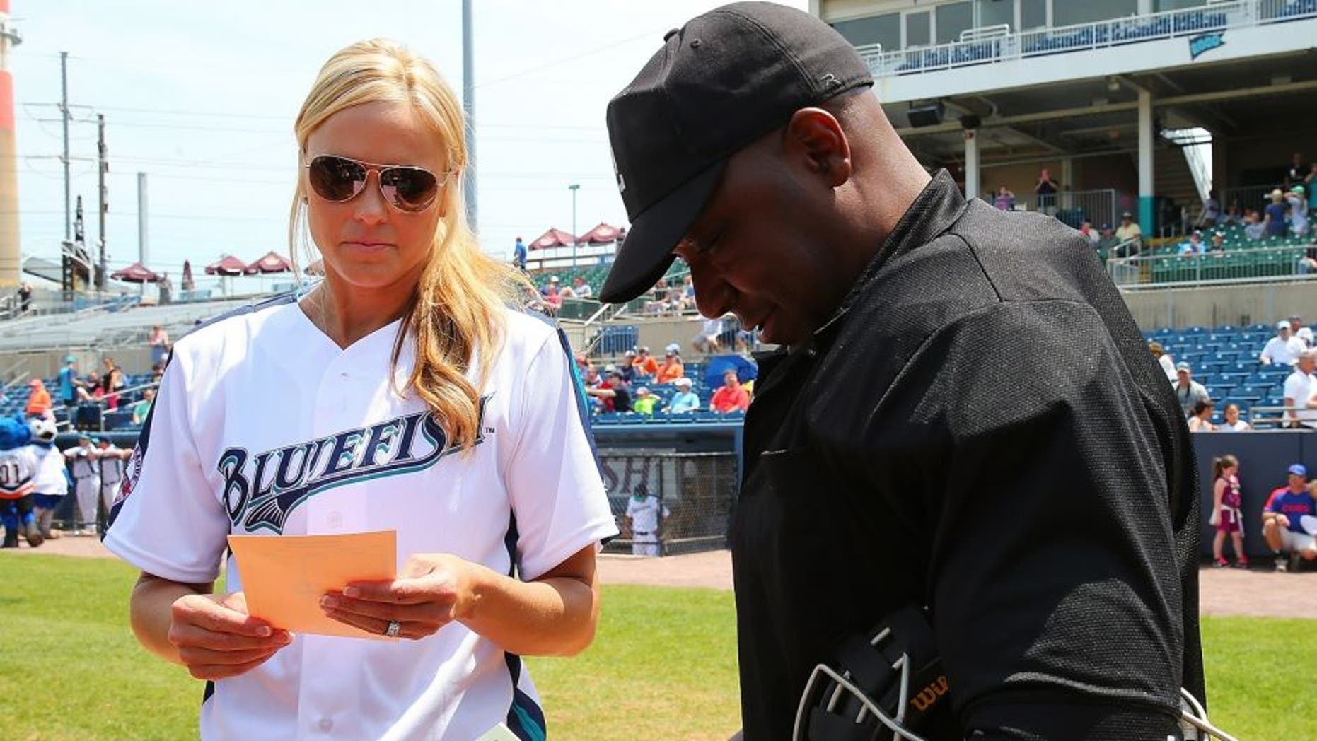 BRIDGEPORT, CT - MAY 29: Jennie Finch exchangers line up cards with Home Plate Umpire Warrren Nicholson prior to managing the Bridgeport Bluefish against Southern Maryland Blue Crabs at The Ballpark at Harbor Yards on May 29, 2016 in Bridgeport, Connecticut. Jennie Finch is the first woman to manages a men's independent league baseball game. (Photo by Mike Stobe/Getty Images)