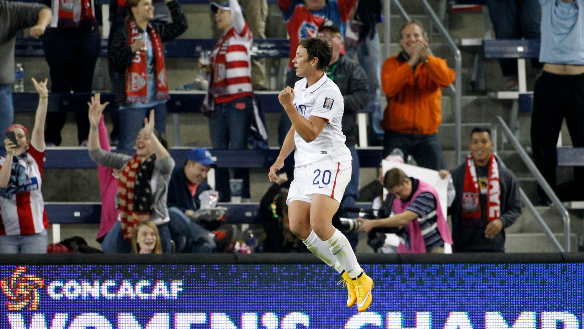 Abby Wambach celebrates her goal against Trinidad and Tobago in this Oct. 15, 2014, file photo.