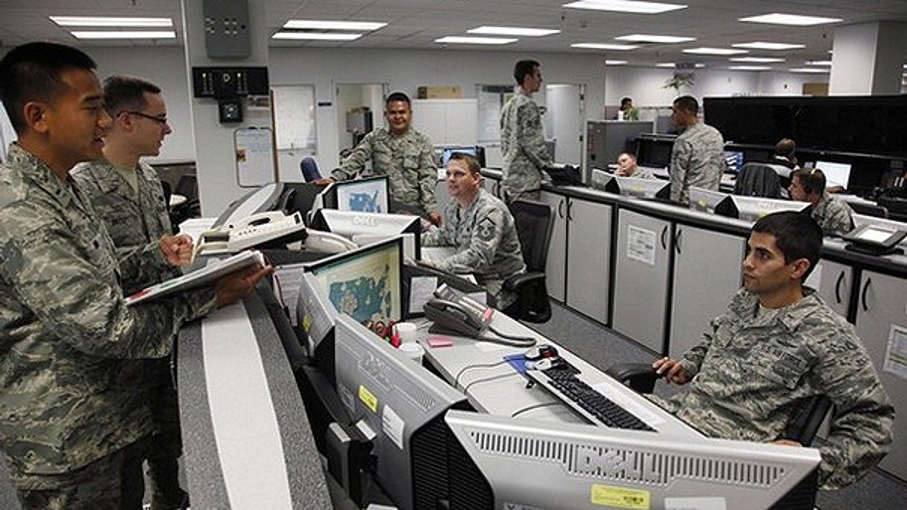 July 20, 2010: Personnel work at the Air Force Space Command Network Operations & Security Center at Peterson Air Force Base in Colorado Springs.