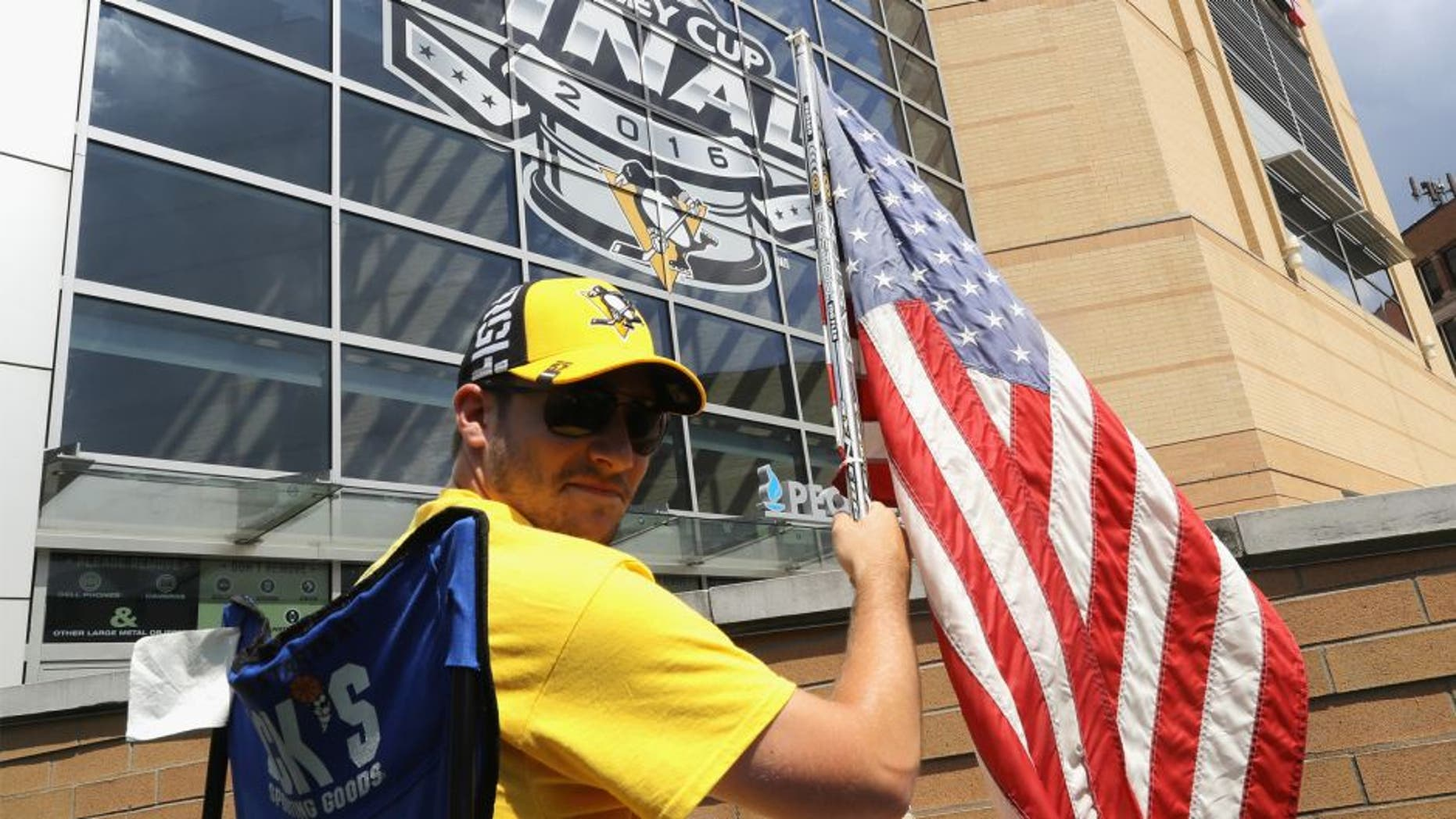 Pittsburgh Penguins fan Nick Comito of Greensburg, PA poses outside of Consol Energy Center prior to Game One of the 2016 NHL Stanley Cup Final between the Pittsburgh Penguins and the San Jose Sharks on May 30, 2016 in Pittsburgh, Pennsylvania. (Photo by Bruce Bennett/Getty Images)