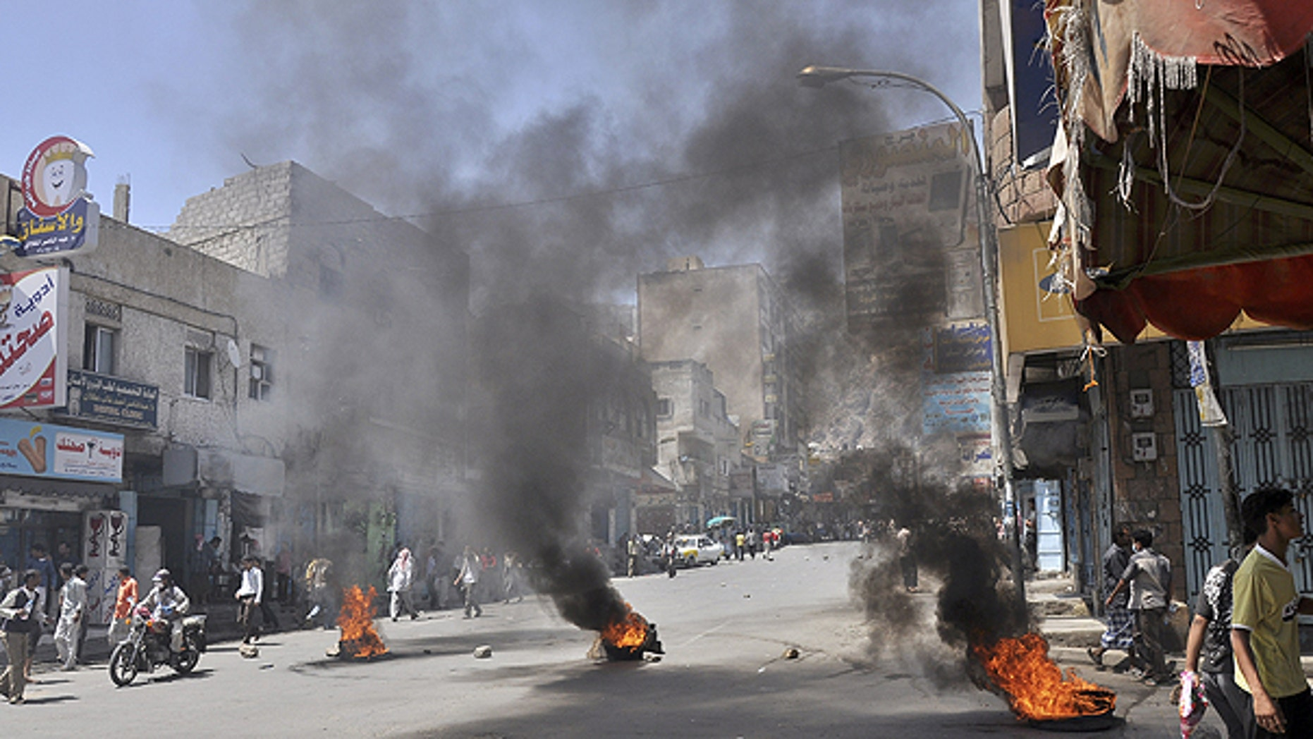 May 31: Burning tires left by anti-government protestors as they block the road during clashes with Yemeni security forces in Taiz, Yemen.