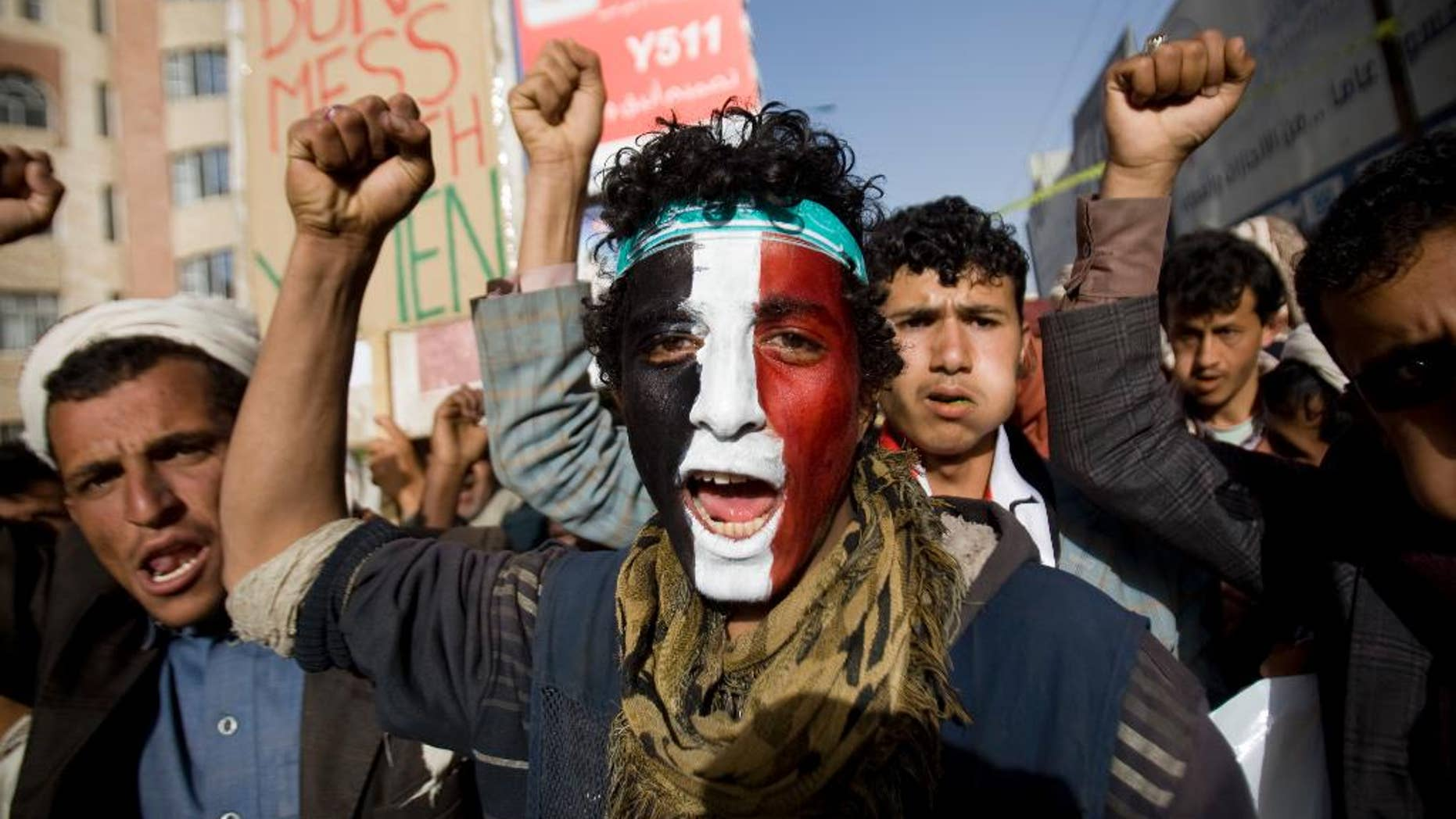 A Houthi Shiite rebel with Yemen's flag painted on his face chants slogans during a rally to show support for leader of rebels, Abdel-Malik al-Houthi in Sanaa, Yemen, Friday, Feb. 27, 2015. Yemen's Shiite rebel leader lashed out at Saudi Arabia on Thursday, accusing it of seeking to split the country following his group's power grab, as a U.N. envoy met the embattled Yemeni president who has fled the capital, Sanaa. (AP Photo/Hani Mohammed)