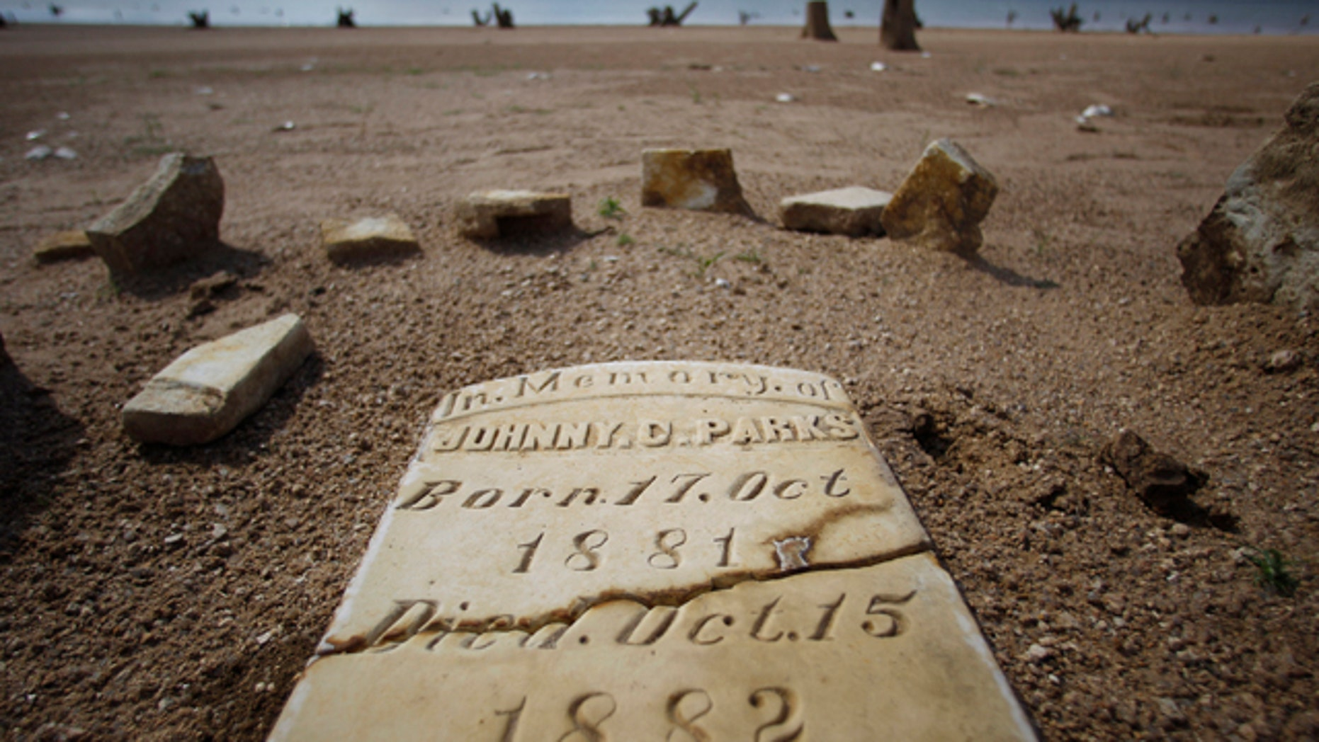 Oct. 5, 2011: A child's grave site, normally at least 20 to 30 feet underwater, has joined other remnants of old Bluffton, Texas, resurfacing on the now dry, sandy lake near Bluffton, as the Texas drought shrinks the state's largest inland lake.