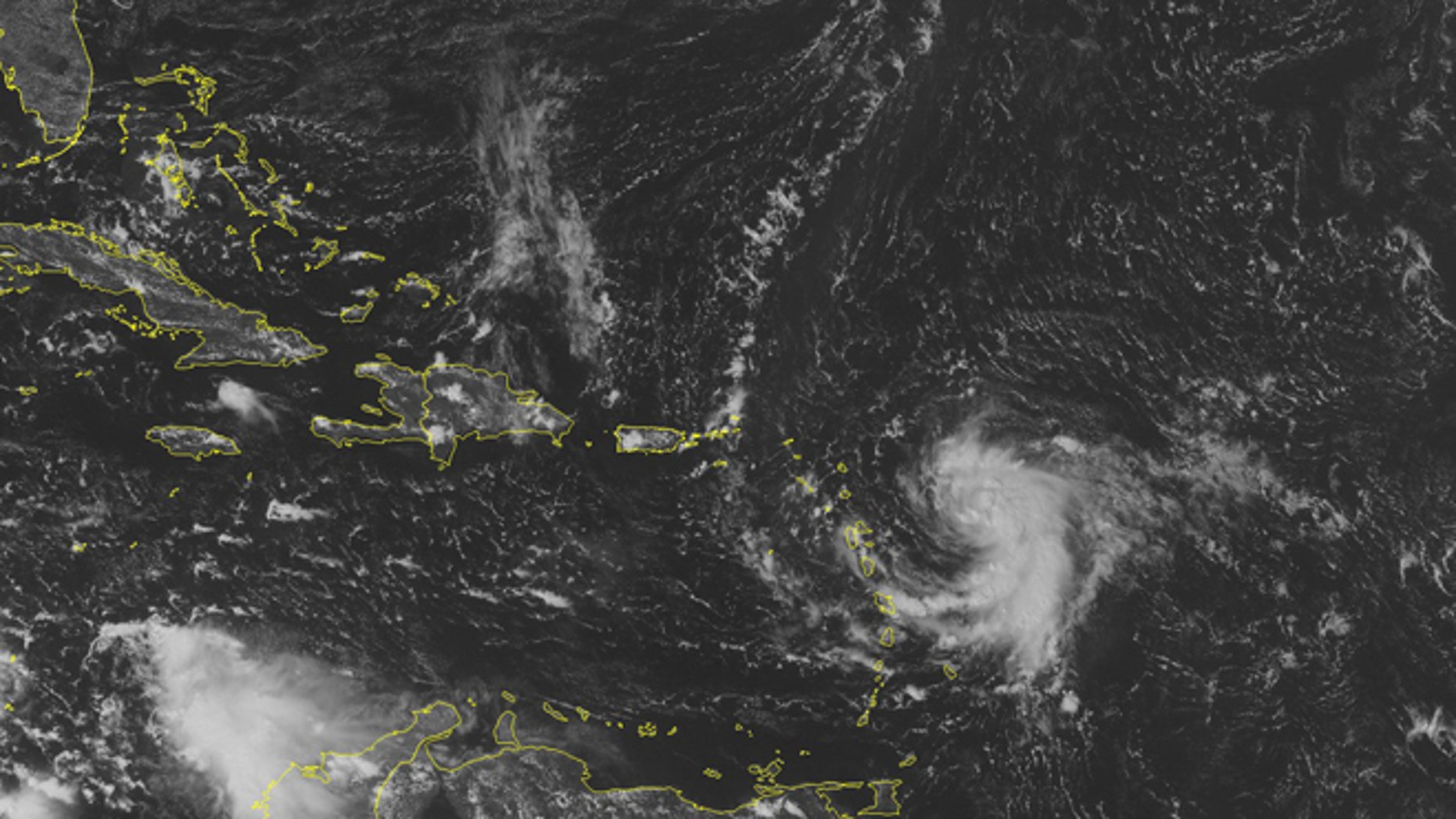 This NOAA satellite image taken Sunday, October 12, 2014 at 01:45 PM EDT shows Tropical Storm Fay just to the northeast of Bermuda moving out into the central Atlantic. Newly formed Tropical Storm Gonzalo moves into the Lesser Antilles with maximum wind gusts of 40 miles per hour. Tropical Storm Warnings are active for the northern islands and Tropical Storm Watches are active for Puerto Rico. (AP Photo/Weather Underground)
