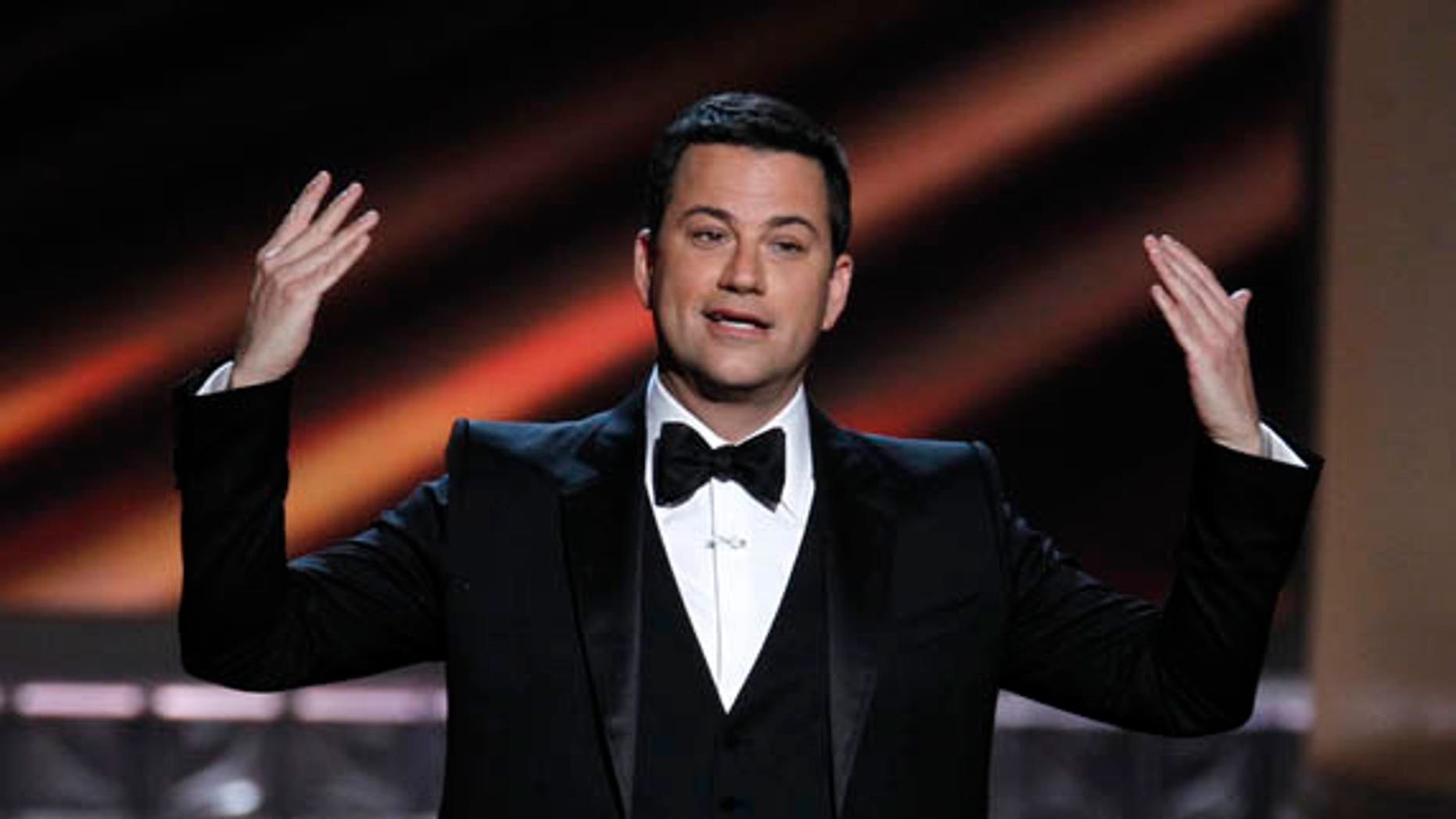 Host Jimmy Kimmel opens the show at the 64th Primetime Emmy Awards in Los Angeles, September 23, 2012.   REUTERS/Lucy Nicholson (UNITED STATES  - Tags: ENTERTAINMENT)  (EMMYS-SHOW)