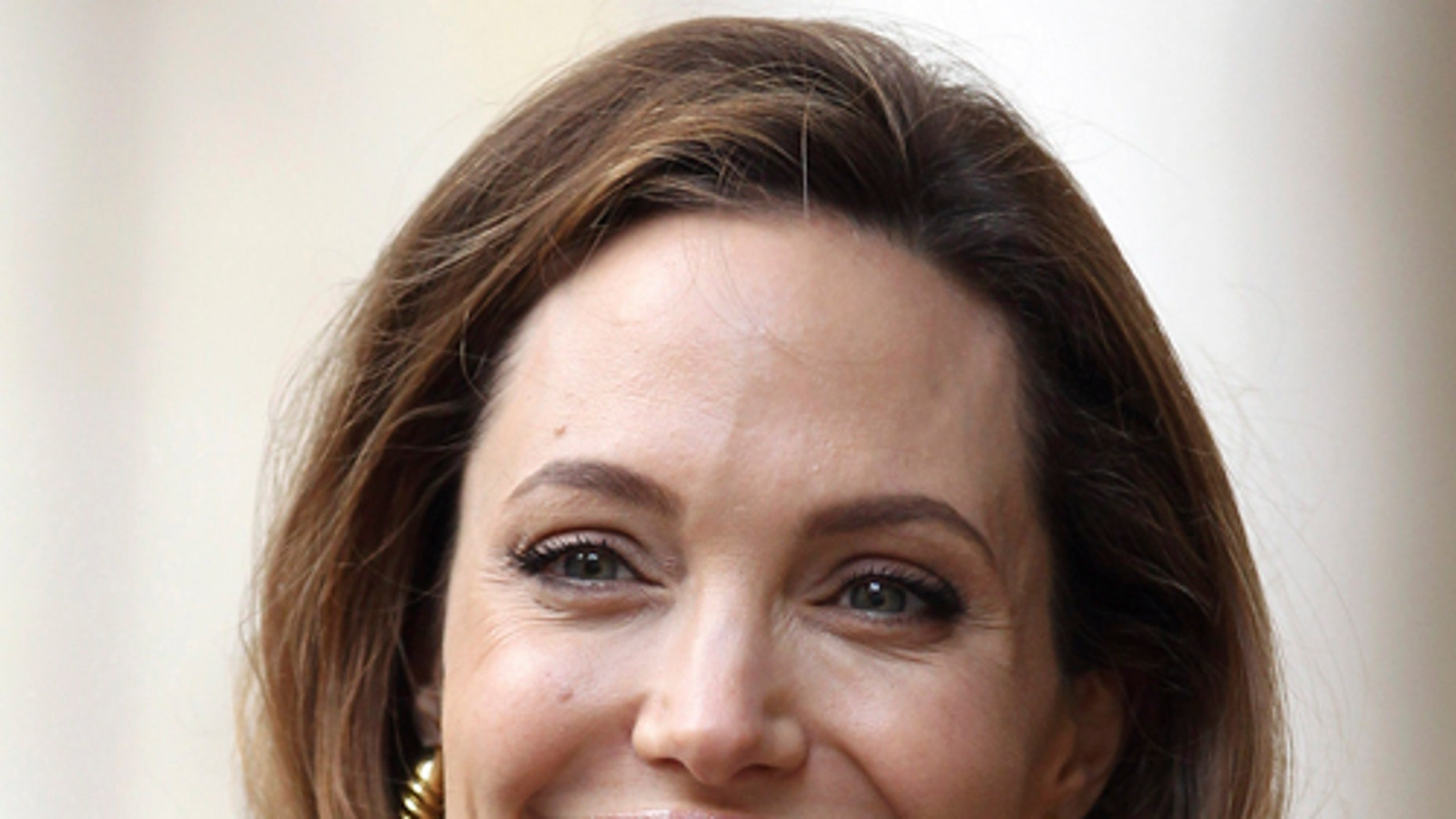 May 29, 2012: Angelina Jolie arrives to Britain's Foreign Secretary William Hague ahead of a screening of her new film 'In the Land of Blood and Honey' at the Foreign Commonwealth Office in central London.