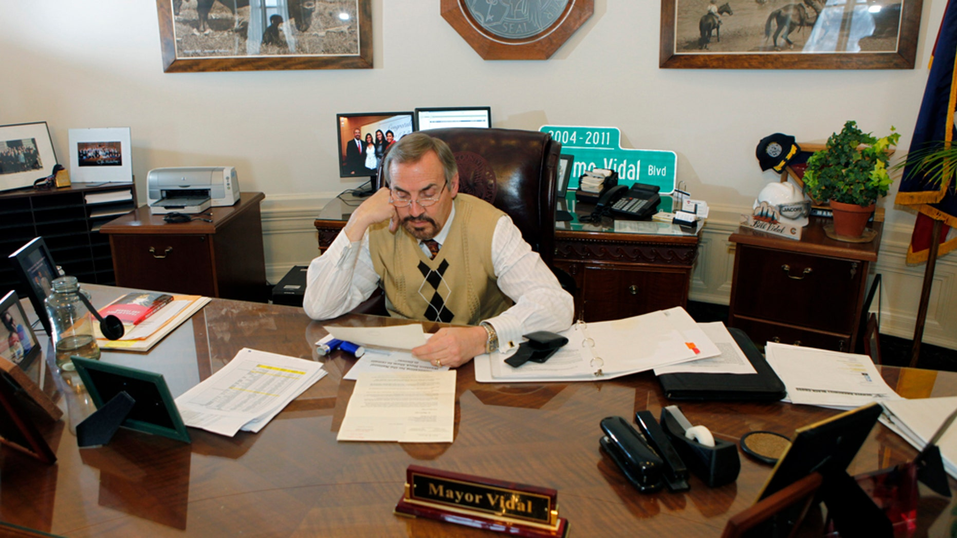 """This photo taken on Tuesday, Feb. 1, 2011 shows Mayor Guillermo """"Bill"""" Vidal at work in his office in Denver. (AP Photo/Ed Andrieski)"""