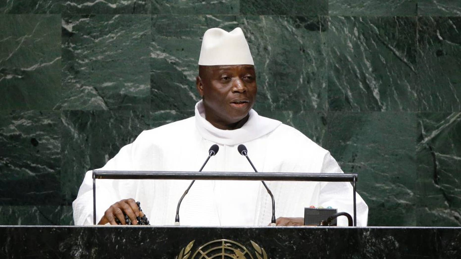 """FILE - In this Sept. 25, 2014, file photo, Gambia's President Yahya Jammeh addresses the 69th session of the United Nations General Assembly at the United Nations headquarters. A third African country, Gambia, says it will leave the International Criminal Court as fears grow of a mass pullout from the body that pursues some of the world's worst atrocities. Gambia announced the decision on television Tuesday, Oct. 25, 2016, accusing the court of unfairly targeting Africa and calling it the """"International Caucasian Court."""" (AP Photo/Frank Franklin II, File)"""
