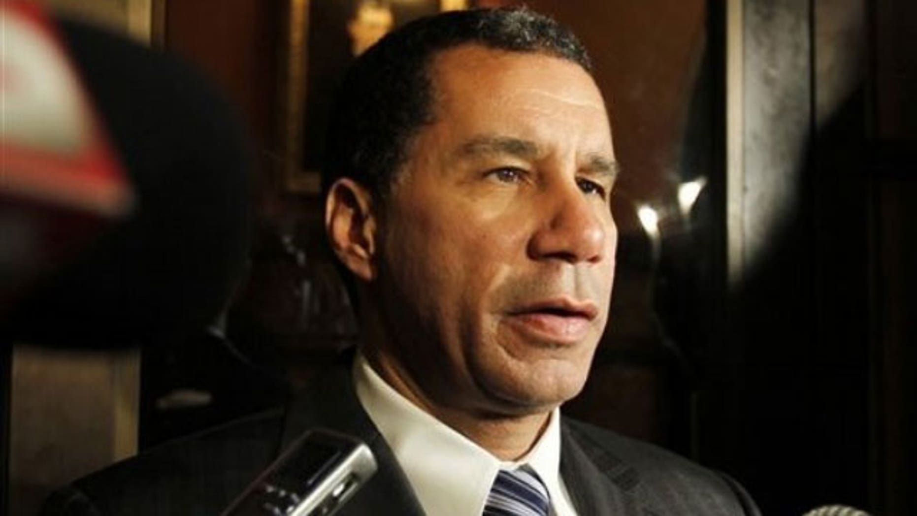 May 12: Gov. David Paterson talks to reporters outside his office at the Capitol in Albany, N.Y. (AP).