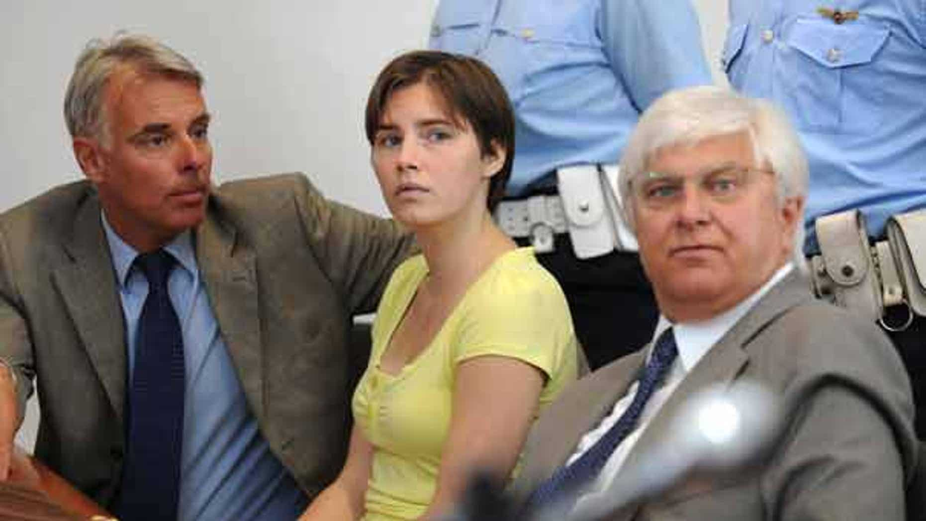 Amanda Knox sits between her two lawyers during a preliminary hearing in Perugia, Italy.