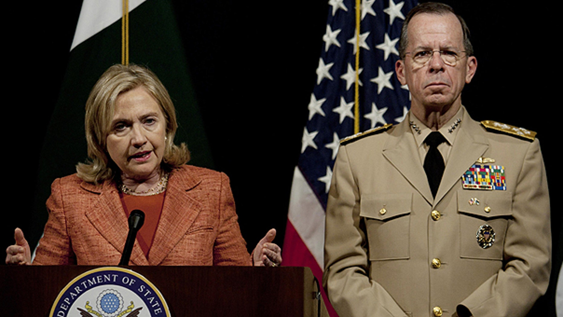May 27: U.S. Secretary of State Hillary Rodham Clinton addresses a news conference with Adm. Mike Mullen, the chairman of the U.S. Joint Chiefs of Staff at U. S. embassy in Islamabad, Pakistan.