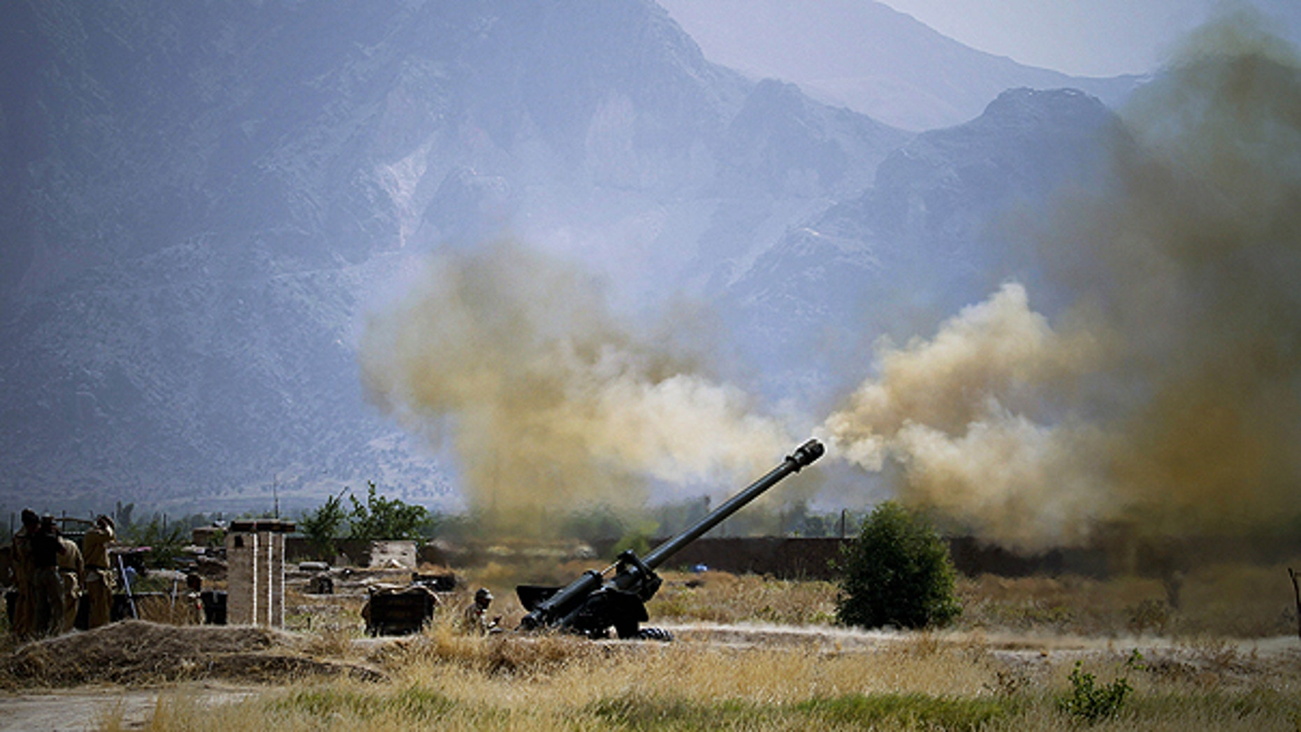June 1: Pakistani troops fire heavy artillery toward alleged militants hideouts in the mountain ranges in Mamad Gat, in Pakistan's Mohmand tribal region along the Afghan border.
