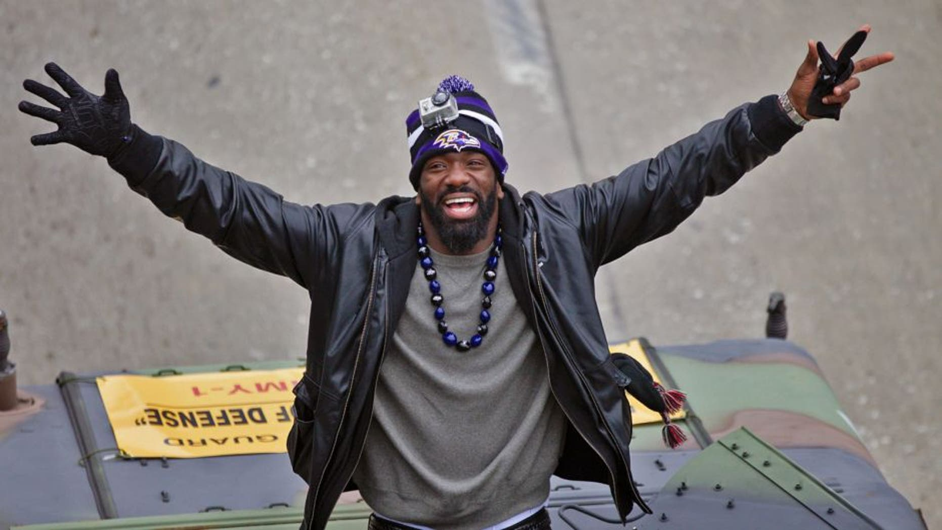 Feb 5, 2013; Baltimore, MD, USA; Baltimore Ravens safety Ed Reed (20) waves to fans during the Baltimore Ravens victory parade and celebration for Super Bowl XLVII through the streets of Baltimore. Mandatory Credit: Maxwell Kruger-USA TODAY Sports