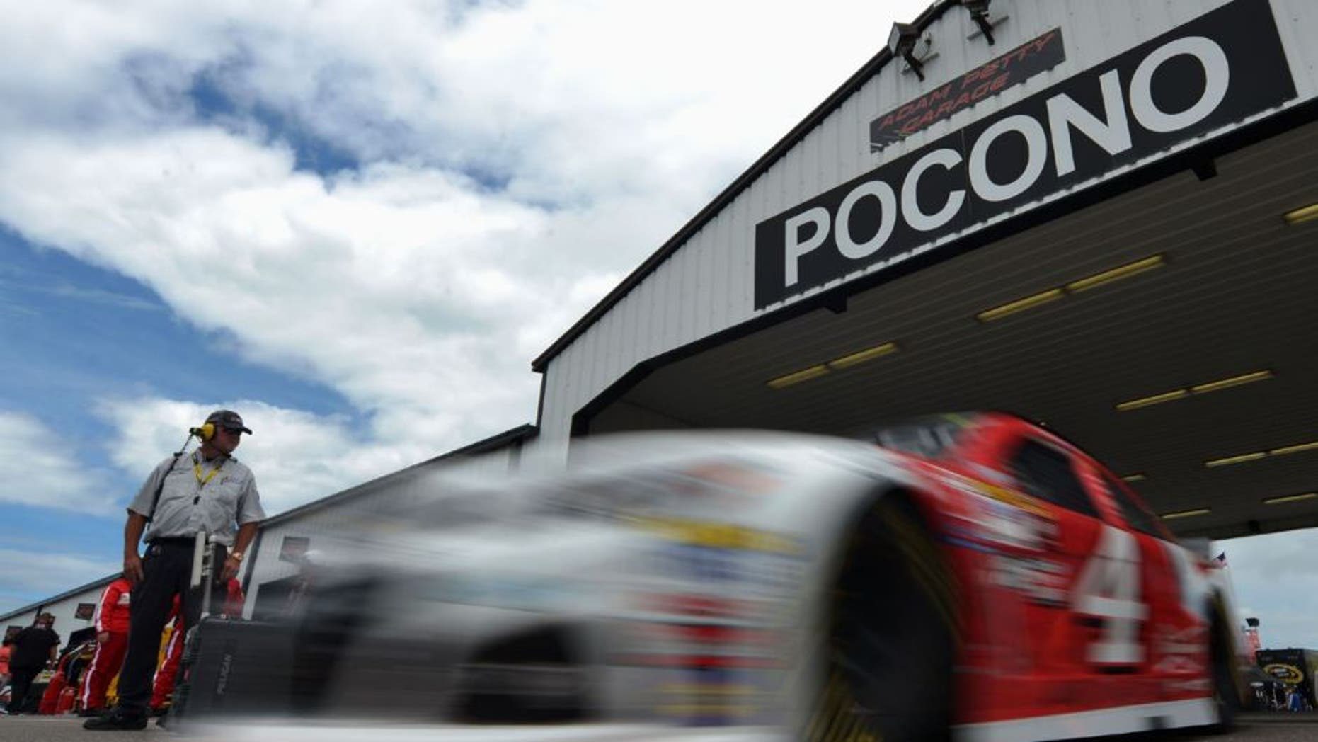 """LONG POND, PA - JUNE 05: Kevin Harvick, driver of the #4 Budweiser/Jimmy John's Chevrolet, drives through the garage area during practice for the NASCAR Sprint Cup Series Axalta """"We Paint Winners"""" 400 at Pocono Raceway on June 5, 2015 in Long Pond, Pennsylvania. (Photo by Drew Hallowell/Getty Images)"""
