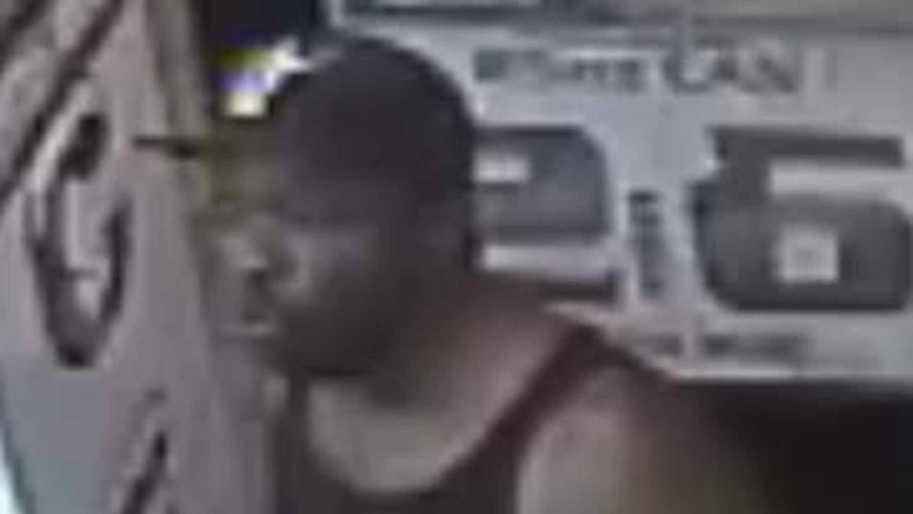 This image made from a surveillance video provided by the City of Detroit Police Department shows a man police are looking to question about the kidnapping of 13-year-old Deontae Mitchell.