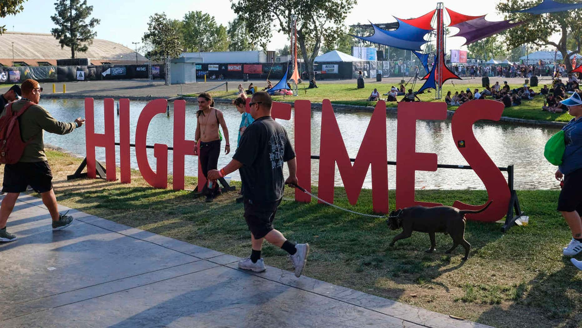 FILE - In this Sunday, April 23, 2017, file photo, visitors arrive at the fairgrounds to attend the High Times Cannabis Cup in San Bernardino, Calif.