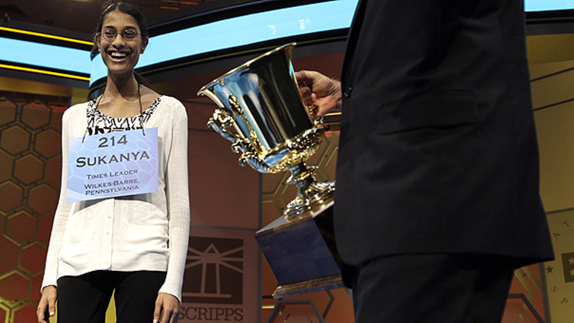 June 2: Sukanya Roy, 14, of South Abington Township, Pa., is presented the trophy after winning the National Spelling Bee, in Oxon Hill, Md.