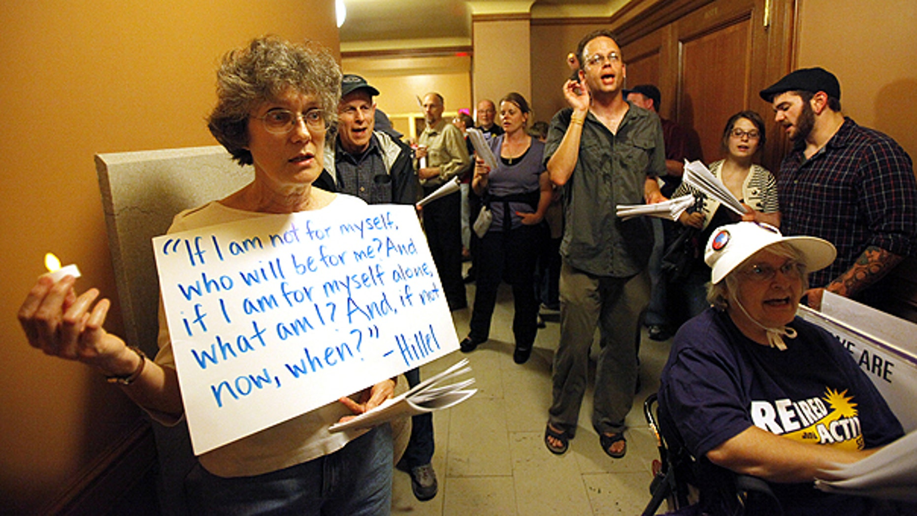 June 2: Protesters wait to be let into a meeting of the Joint Committee on Finance at the state Capitol in Madison, Wis.