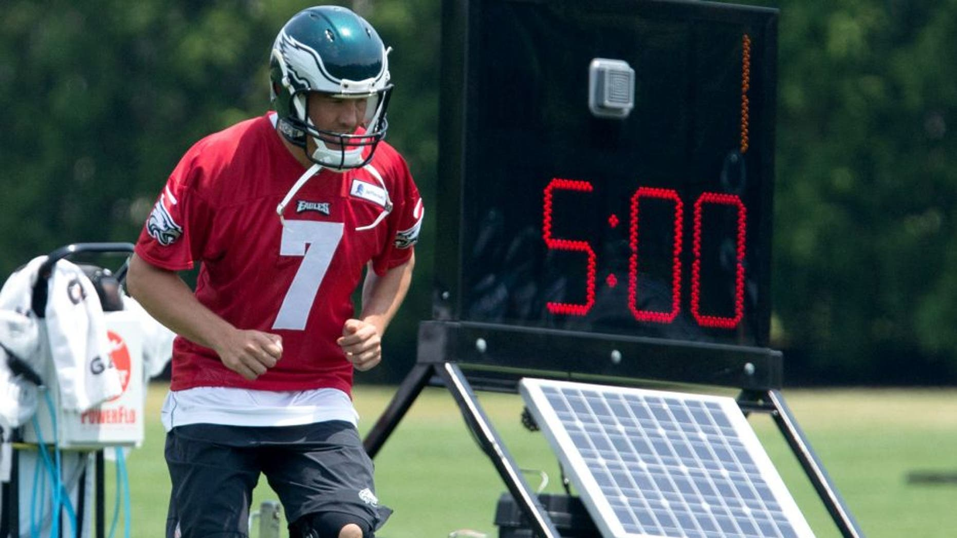 May 28, 2015; Philadelphia, PA, USA; Philadelphia Eagles quarterback Sam Bradford (7) loosens up during OTA's at the NovaCare Complex. Mandatory Credit: Bill Streicher-USA TODAY Sports