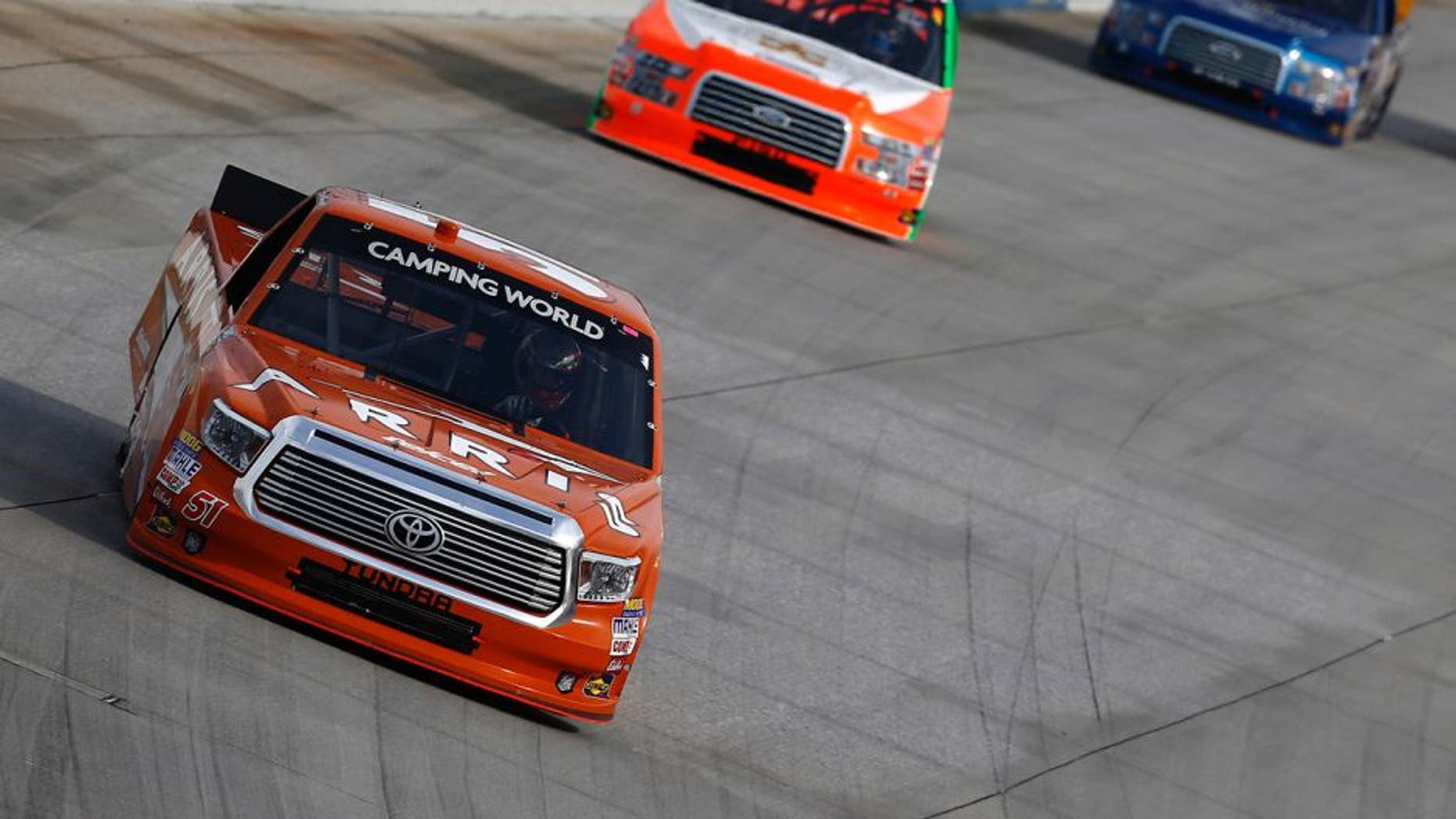DOVER, DE - MAY 13: Daniel Suarez, driver of the #51 ARRIS Toyota, leads a pack of trucks during the NASCAR Camping World Truck Series JACOB Companies 200 at Dover International Speedway on May 13, 2016 in Dover, Delaware. (Photo by Jeff Zelevansky/NASCAR via Getty Images)