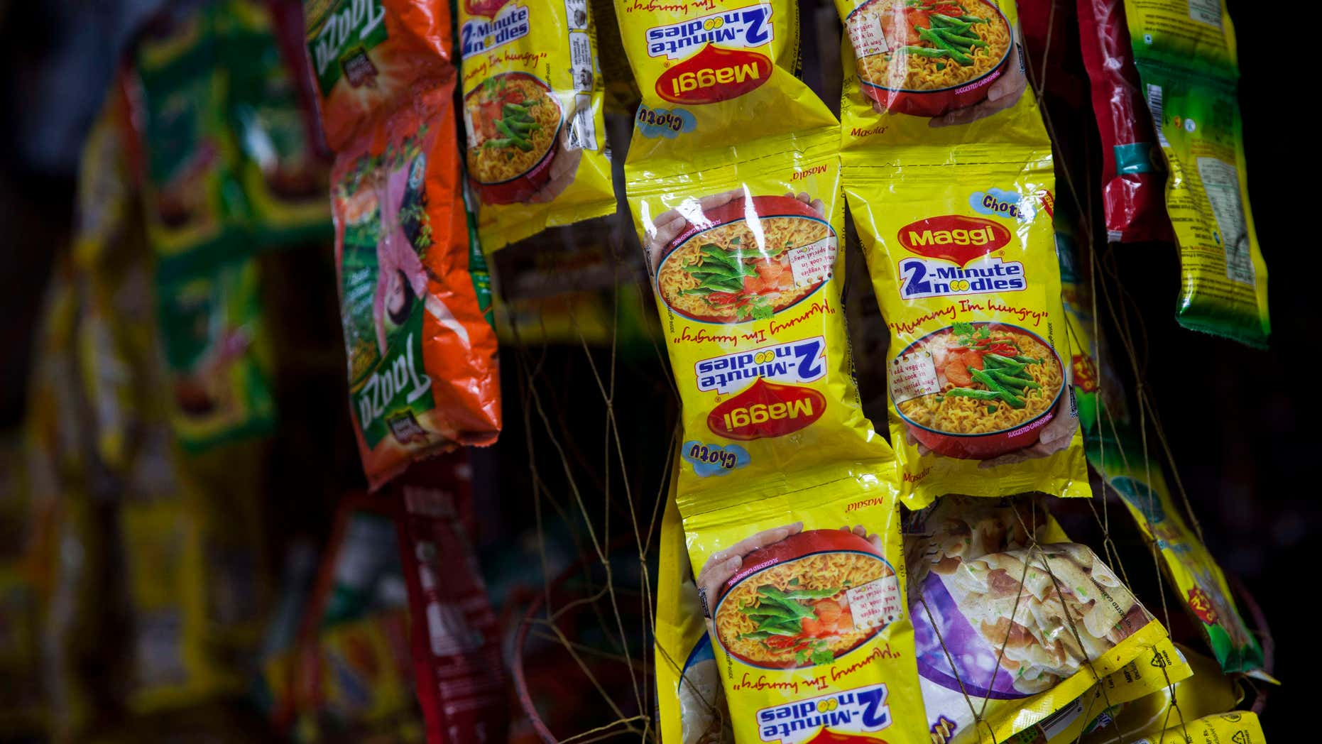 June 3, 2015: Packets of Maggi noodles hang on display at a shop in New Delhi, India.