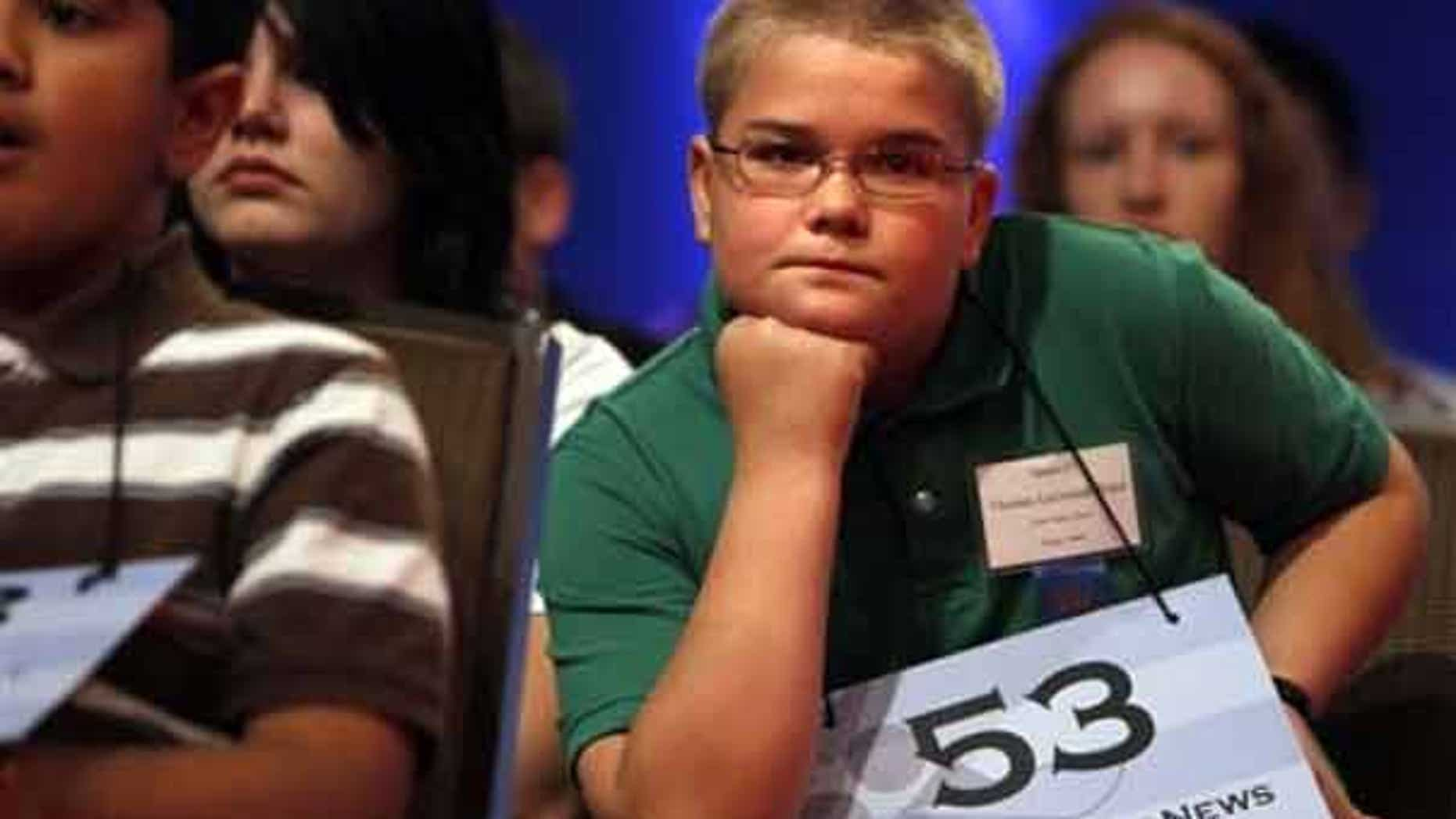 June 3: Thomas Bates, 11, of Driggs, Idaho, looks determined at the start of competition at the 2010 Scripps National Spelling Bee in Washington.