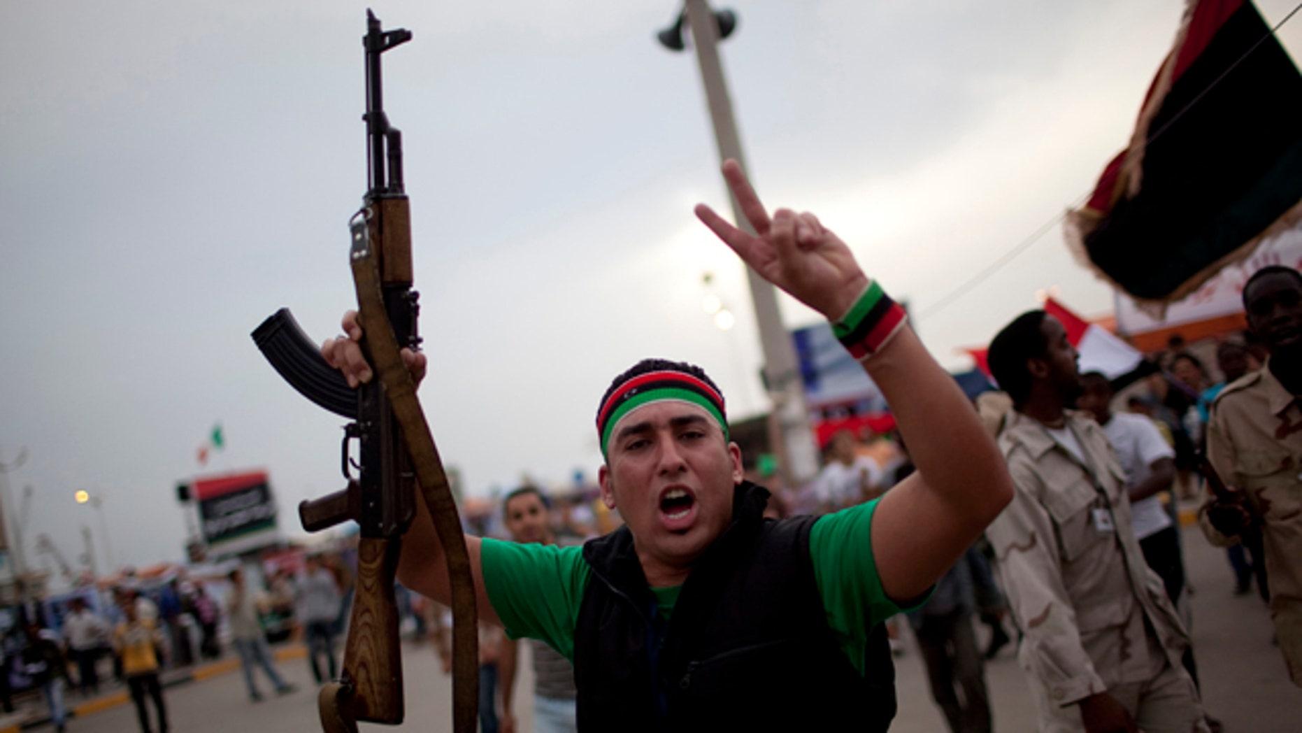 June 3: A man chants anti-Muammar al-Qaddafi slogans during a protest in the rebel strong hold of Benghazi, Libya.
