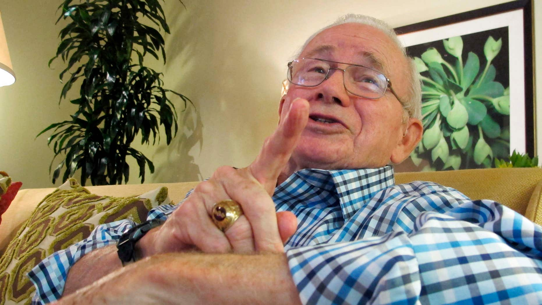 FILE - In this Nov. 26, 2013, file photo, retired Air Force Col. Thomas E. Schaefer discusses his 444 days in captivity in Iran, at his home in Scottsdale, Ariz.