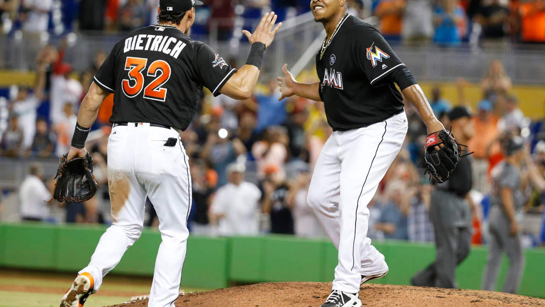 Miami Marlins starting pitcher Edinson Volquez, right, celebrates with Derek Dietrich (32) after throwing a no-hitter as the Marlins defeated the Arizona Diamondbacks 3-0 during a baseball game, Saturday, June 3, 2017, in Miami.