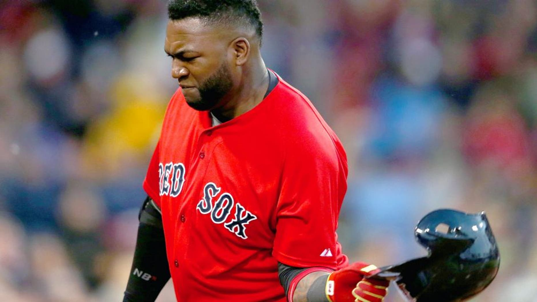 BOSTON, MA - JUNE 3: David Ortiz #34 of the Boston Red Sox throws his helmet after making an out in the fourth inning against the Minnesota Twins during the second game of a doubleheader at Fenway Park on June 3, 2015 in Boston, Massachusetts. (Photo by Jim Rogash/Getty Images)